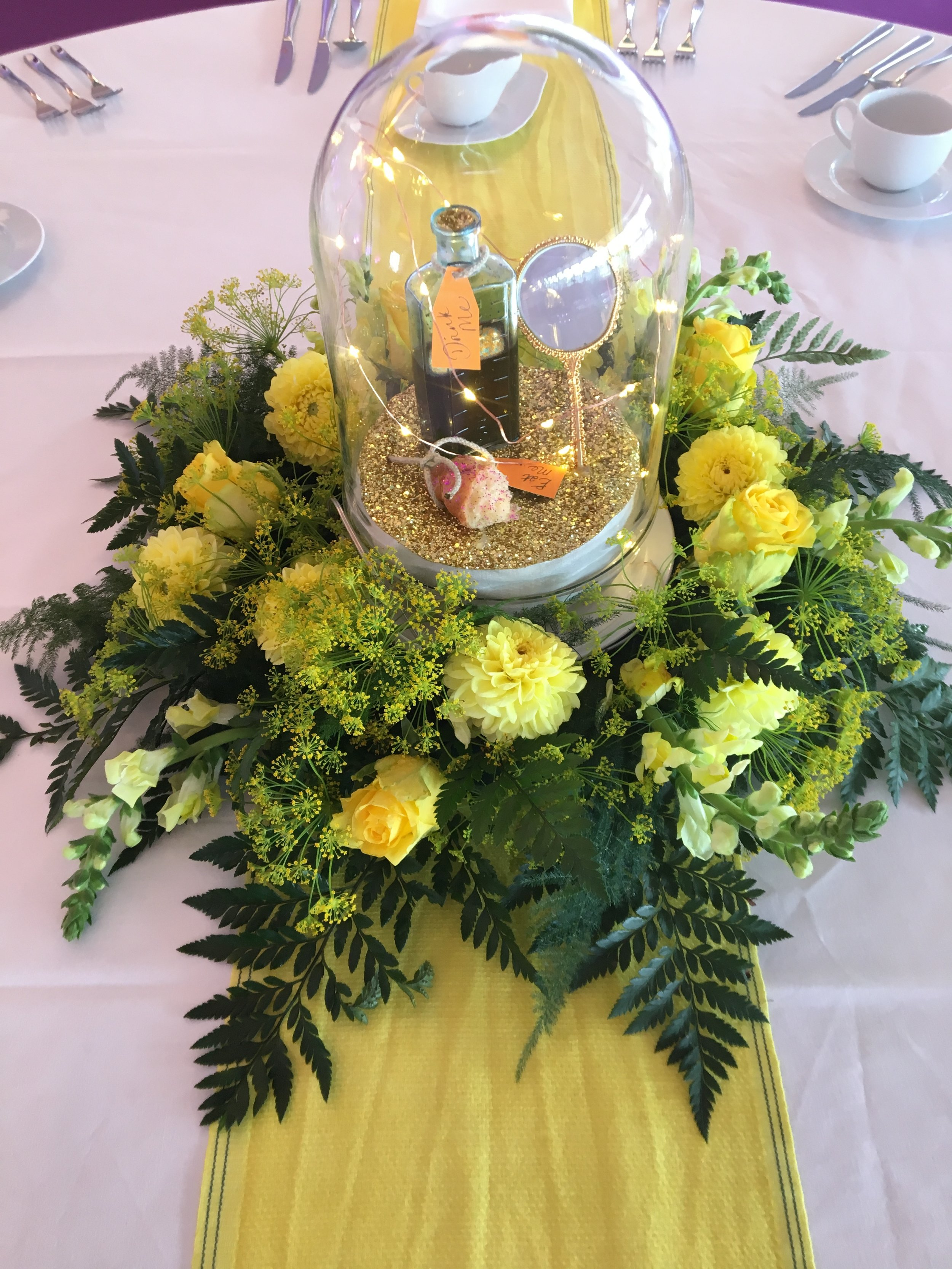 Yellow arrangement and bell jar Theatre Of Flowers.JPG