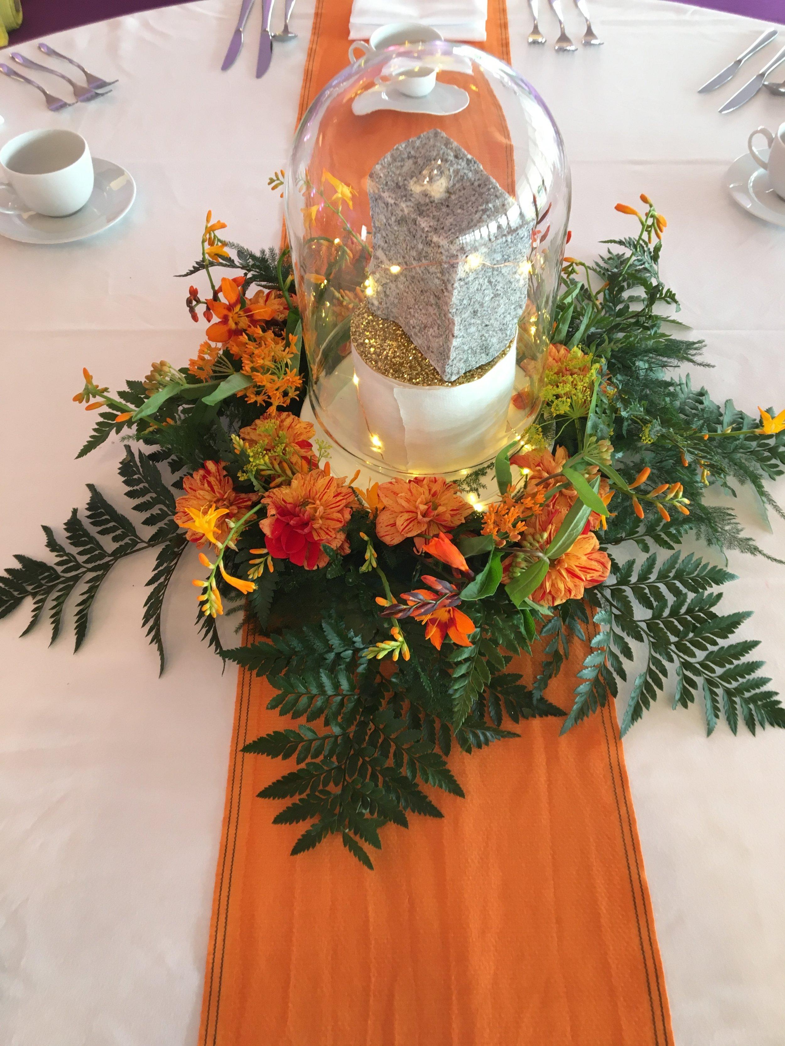 Orange arrangement and bell jar Theatre Of Flowers.JPG
