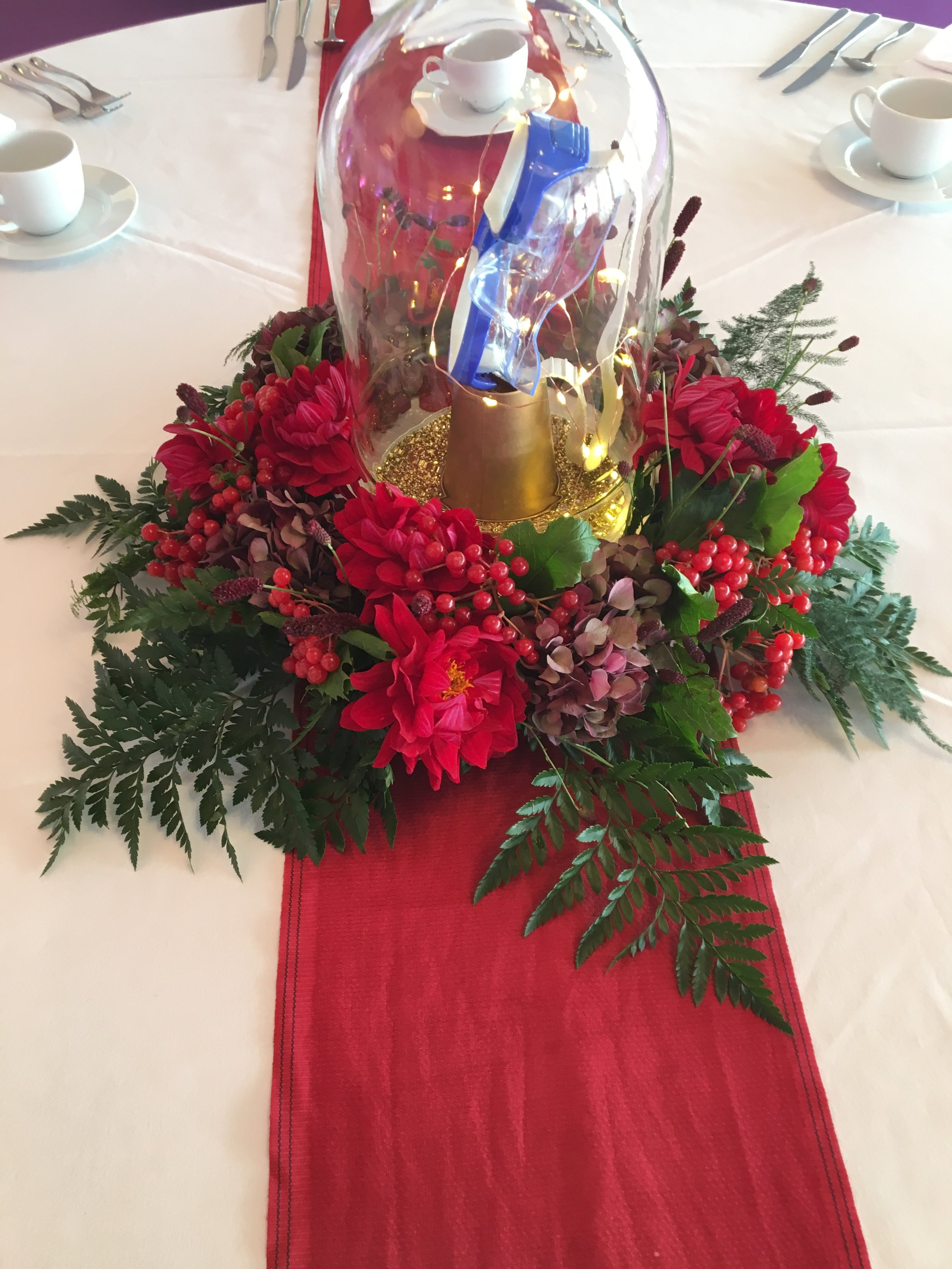 Red arrangement and bell jar Theatre Of Flowers.JPG