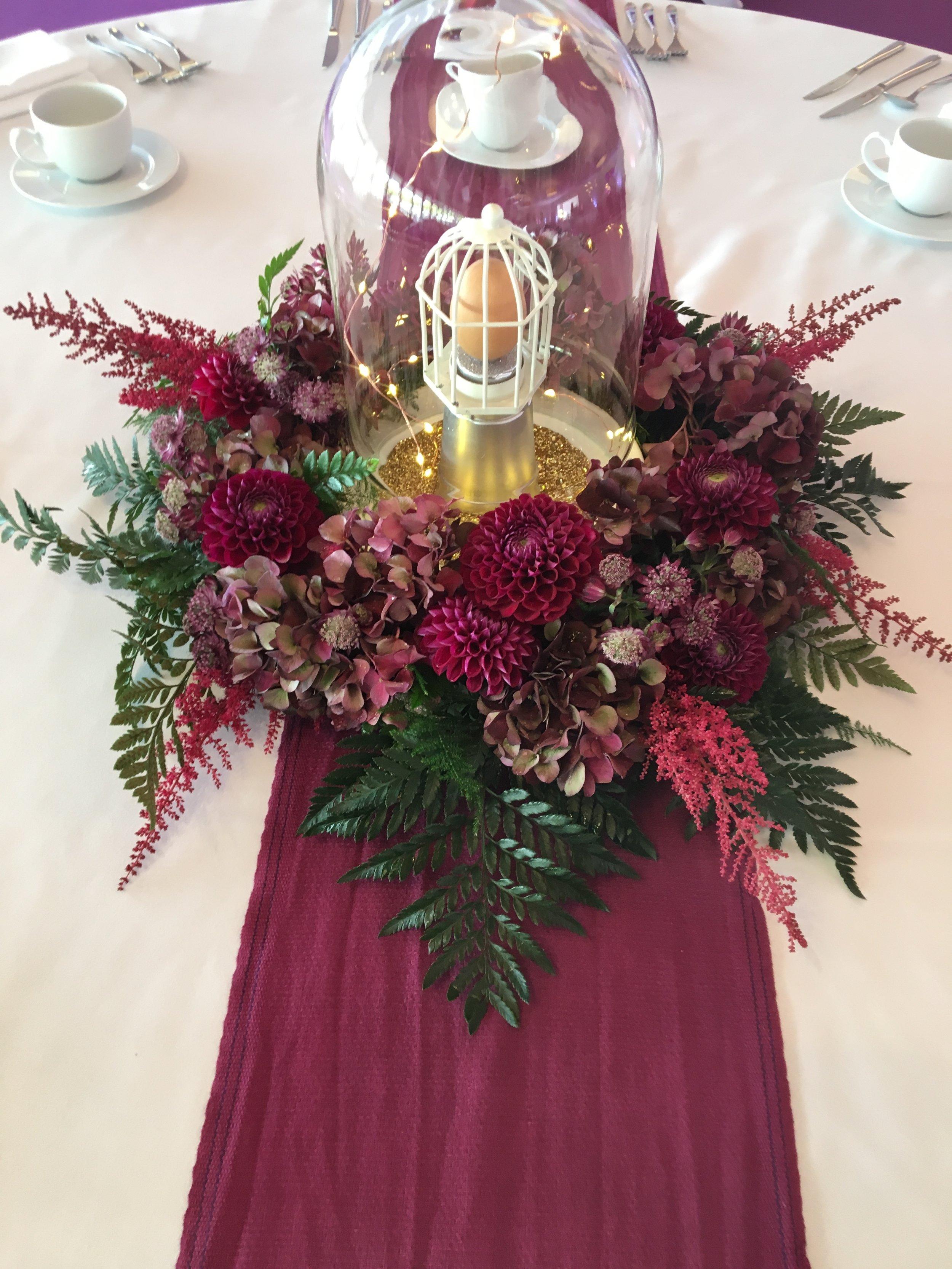Plum arrangement and bell jar Theatre Of Flowers.JPG