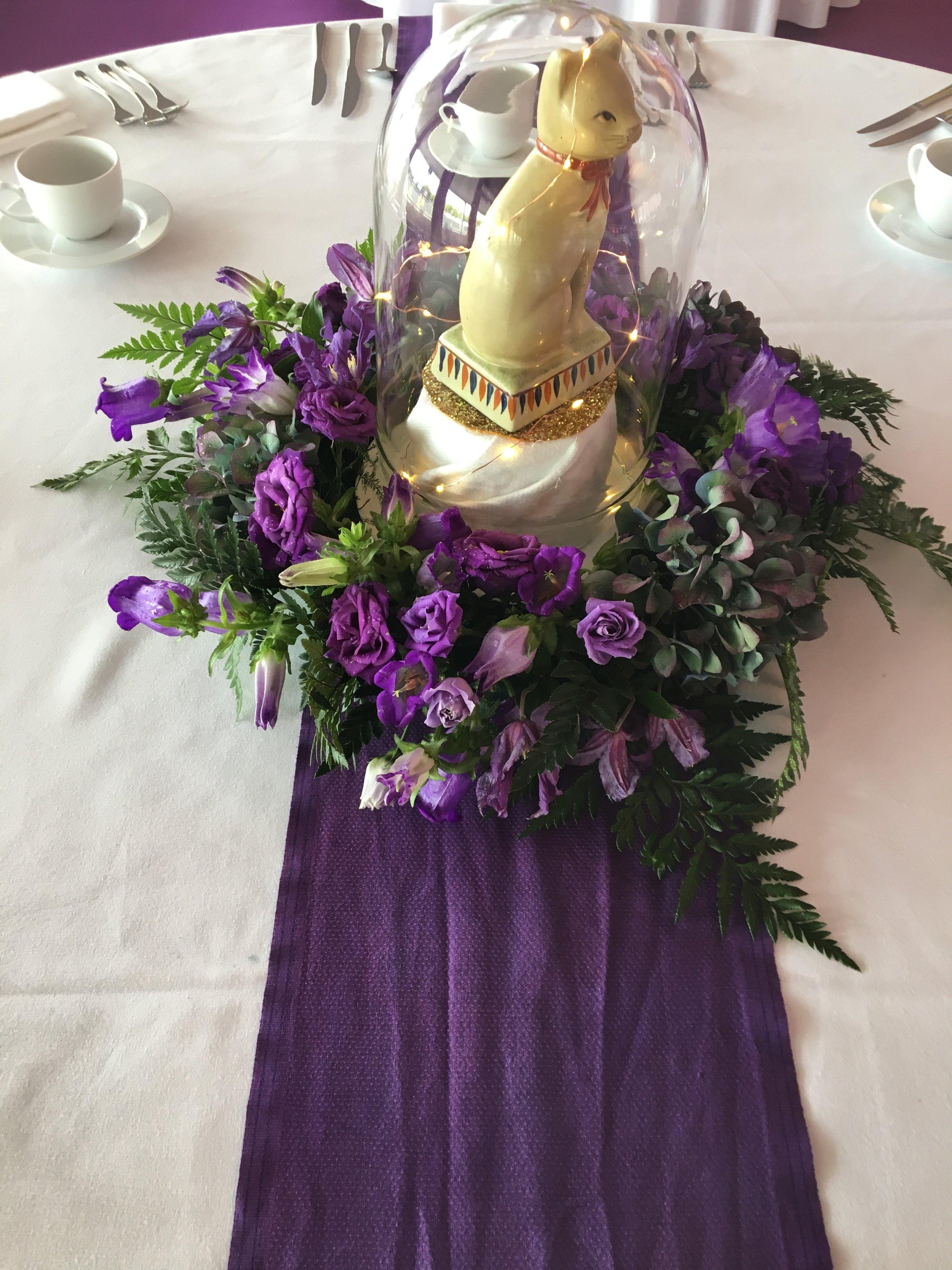 Purple arrangement and bell jar Theatre Of Flowers.JPG