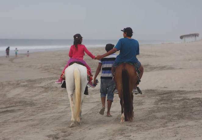 Horse riding along Vichayito beach.