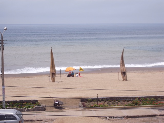 Huanchaco, La Libertad - Reed Boats and Sunbathers.jpeg