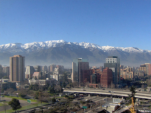 Santiago City with a backdrop of Andean mountains.