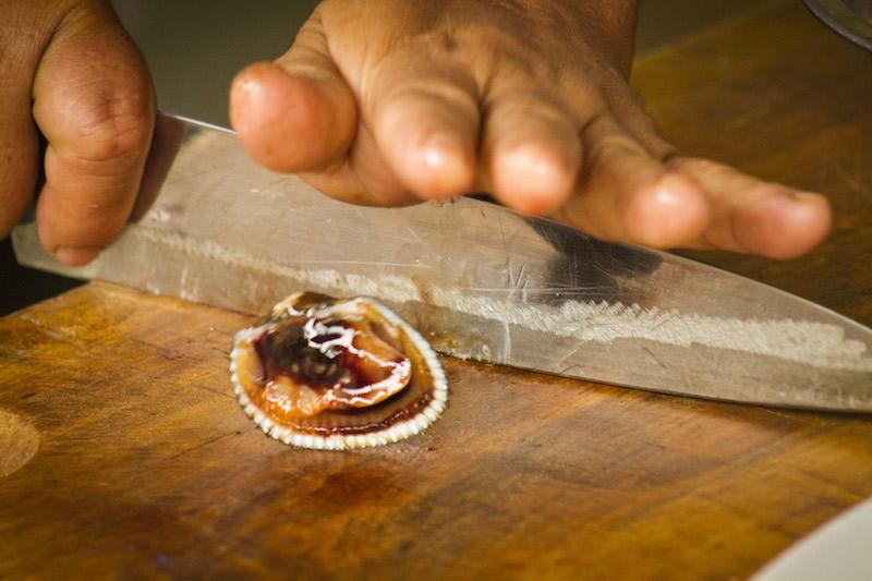 Preparing a scallop for use in ceviche.