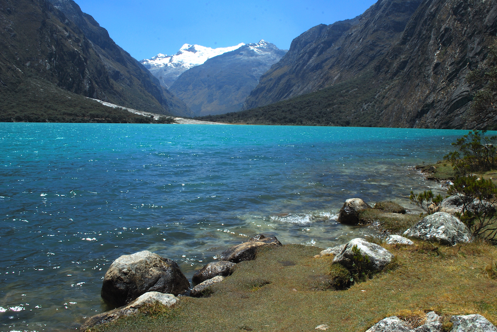 The crystal-blue waters of Llanganuco Lake framed by the mountains of Cordillera Blanca.