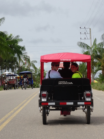 Visitors enjoying a mototaxi ride in Iquitos.