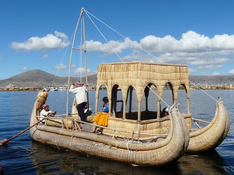 Totora Reed boat with Uros family on Lake Titicaca.
