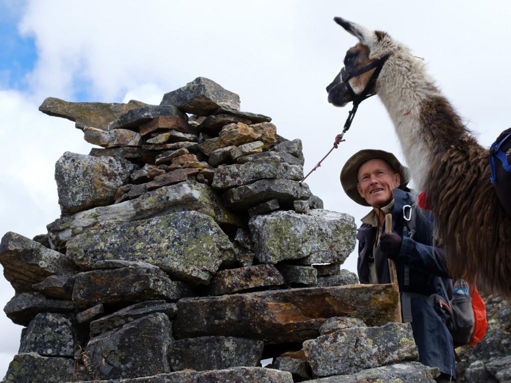 Explorer & llama at  apacheta  on Qhapaq Ñan.