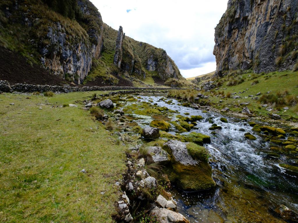 Taparaco River running beside Qhapaq Ñan roadway.