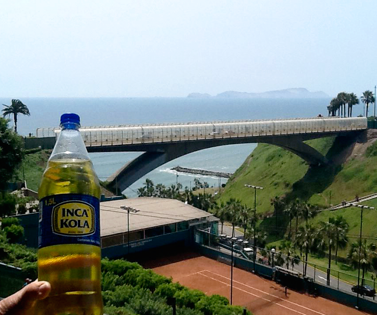 View of Pacific Ocean from Miraflores ... with Inca Kola in foreground.