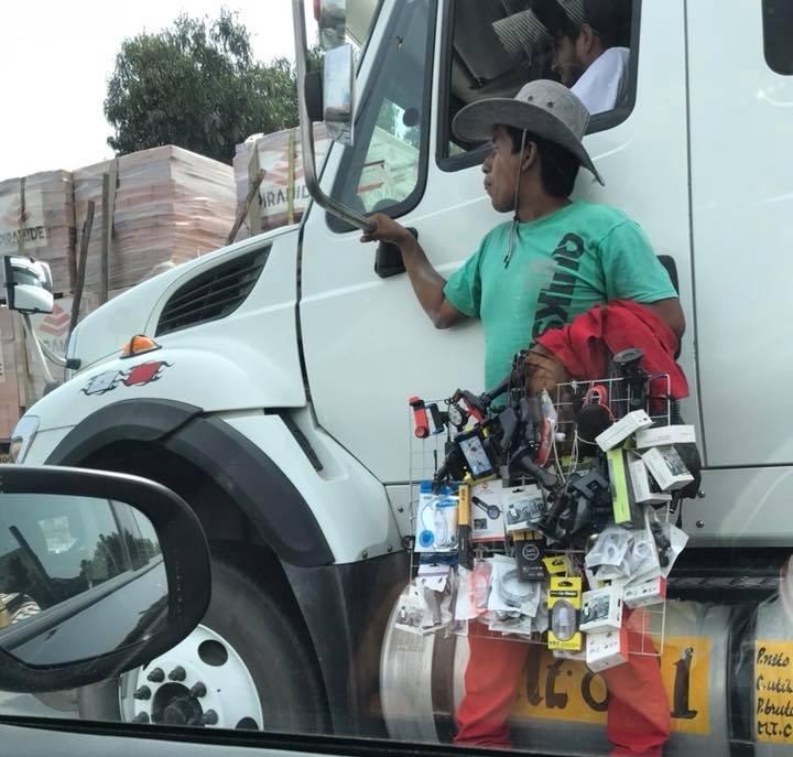 Salesman hitching a ride.