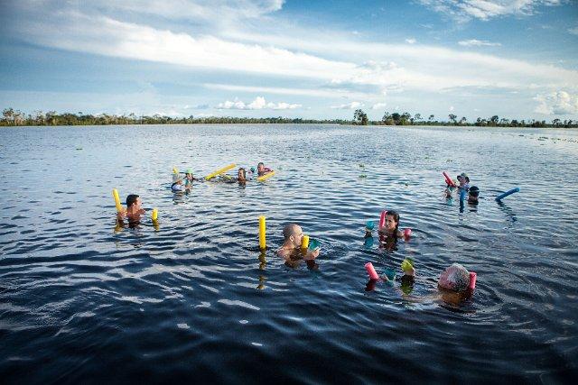 Swimming in Dorado River, Pacaya-Samiria Reserve.