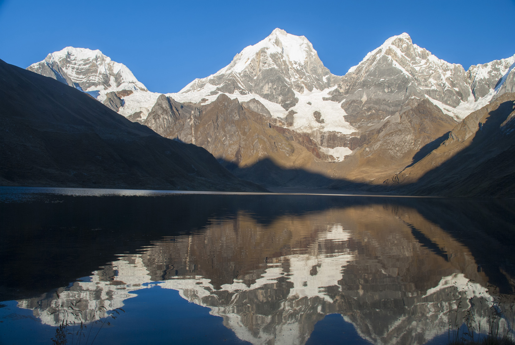 Yerupaja Mountain reflected in Lake Carhuacocha.
