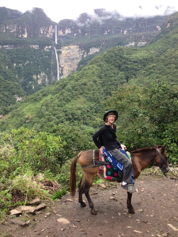 Elizabeth on horseback, with Gocta Waterfall in the background.