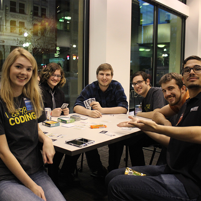 Students play card games at FReX in March 2015.