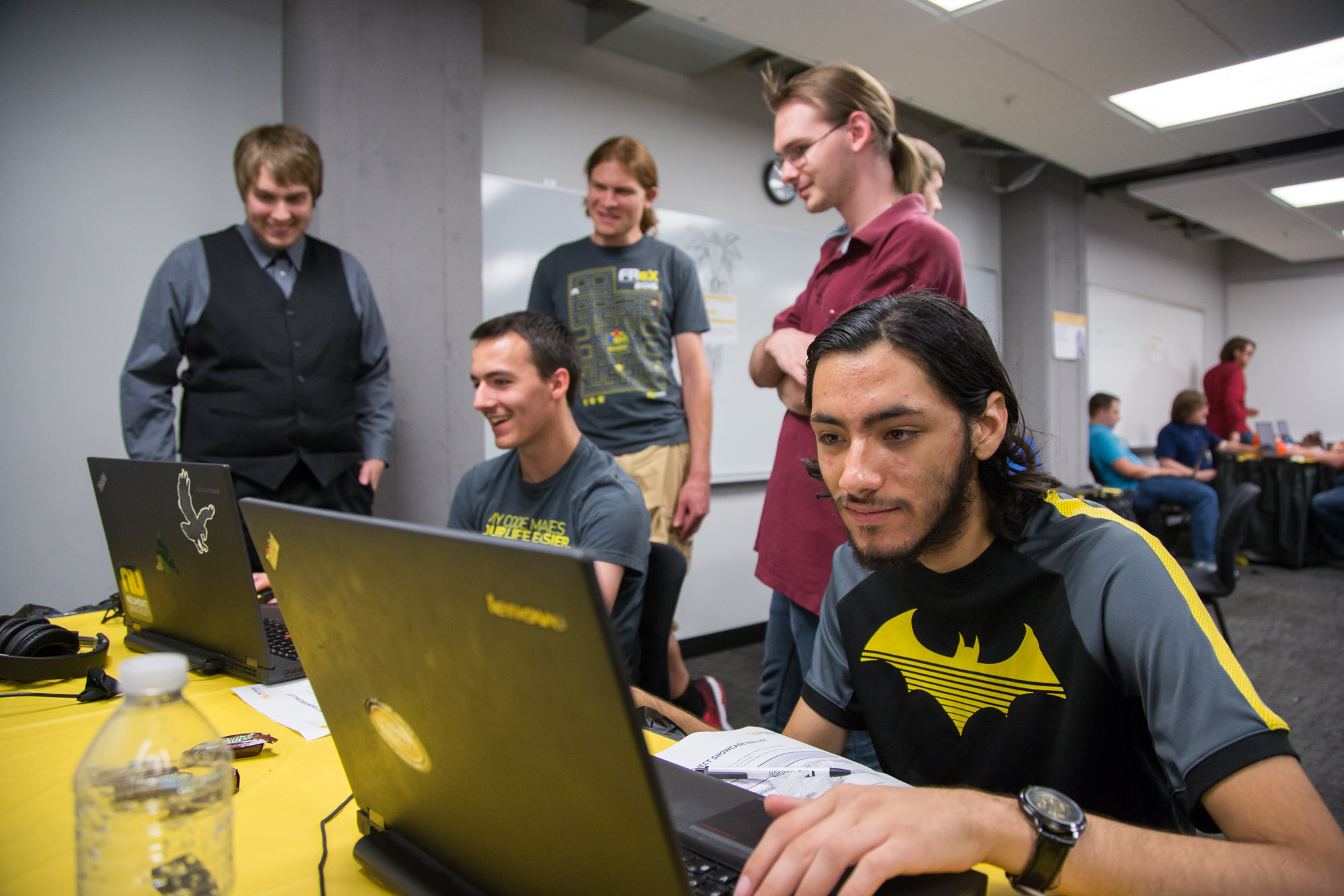 "Students play ""Rogue Bot"" as the dev team looks on."