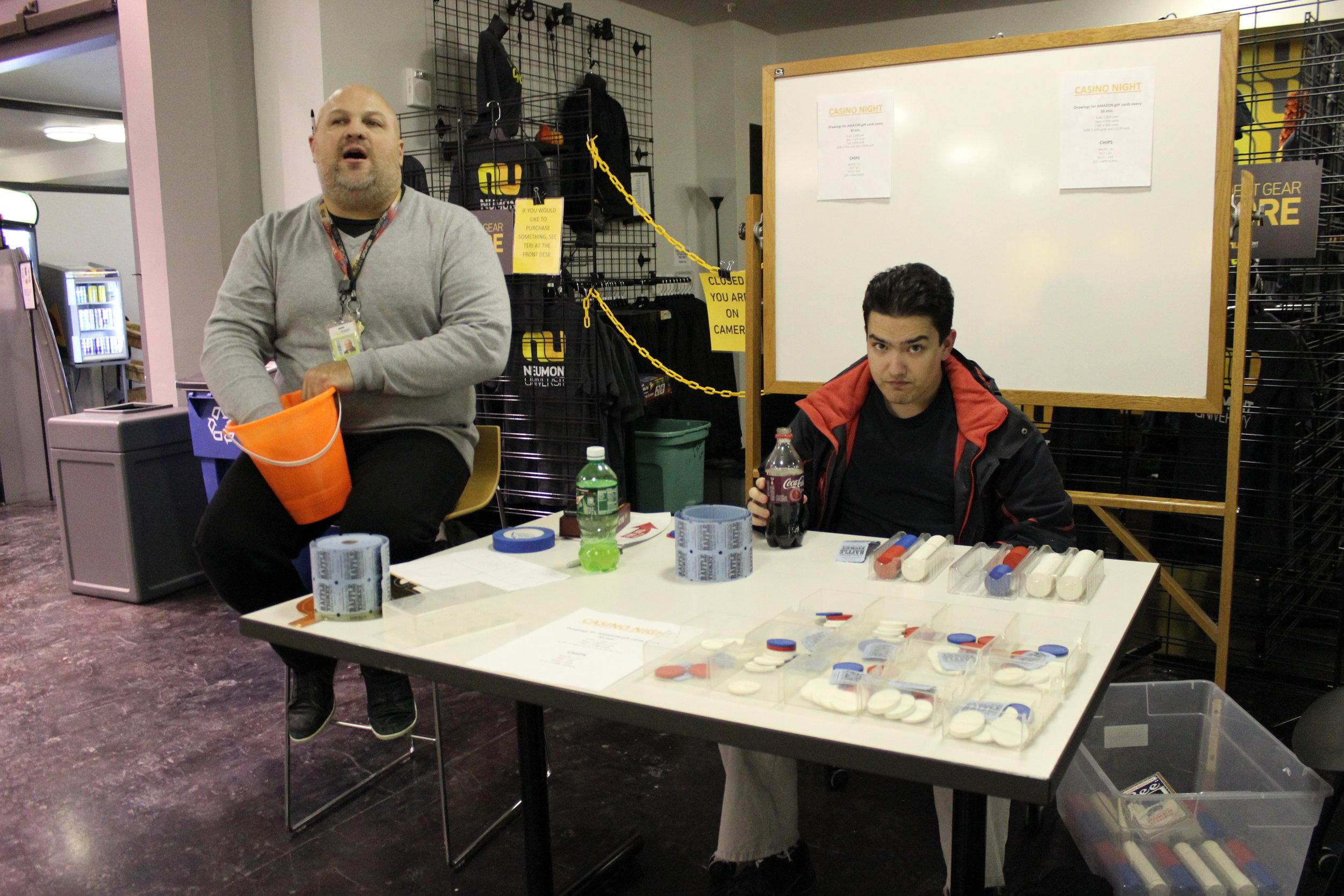 Senior Student Life Coordinator John Peppinger draws the winners during a raffle at Casino Night.