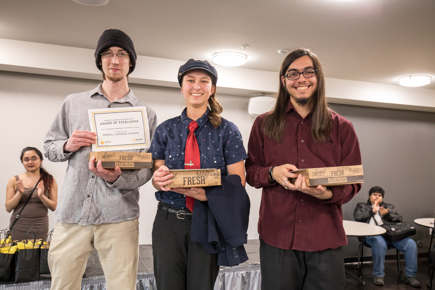"""The DnD Cartographer"" team accepts their pies and awards after winning the overall audience favorite for their tool."