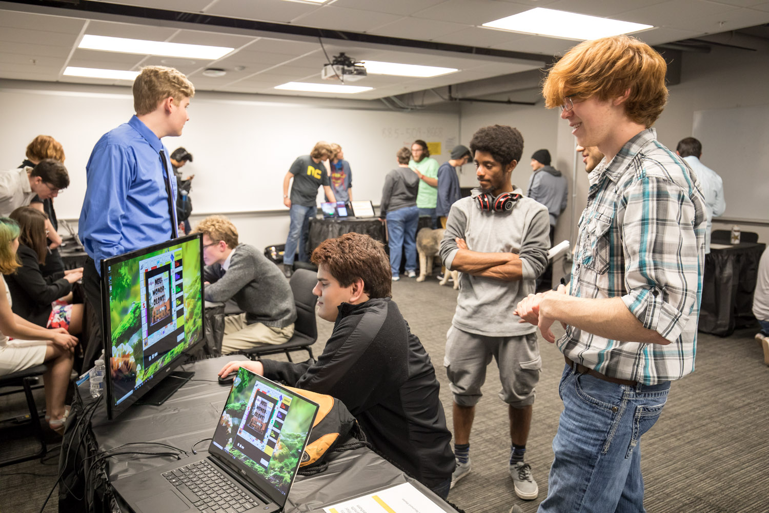 Students demonstrate a game they developed in only 10 weeks at 2018 Project Showcase.