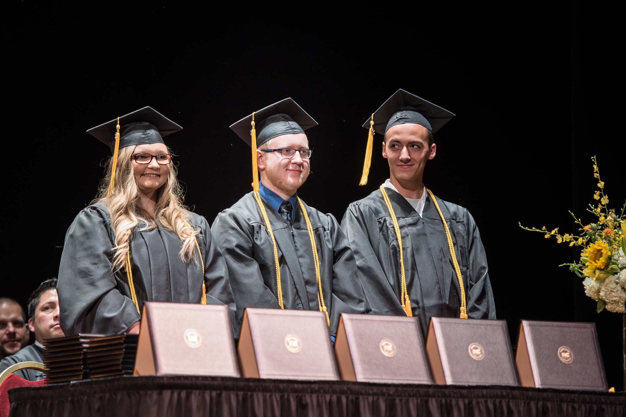 Valedictorian Mary Shultz (Computer Science) and Salutatorians Ben Goff (Computer Science) and Justin Furtado (Software & Game Development) stand to receive their diplomas.