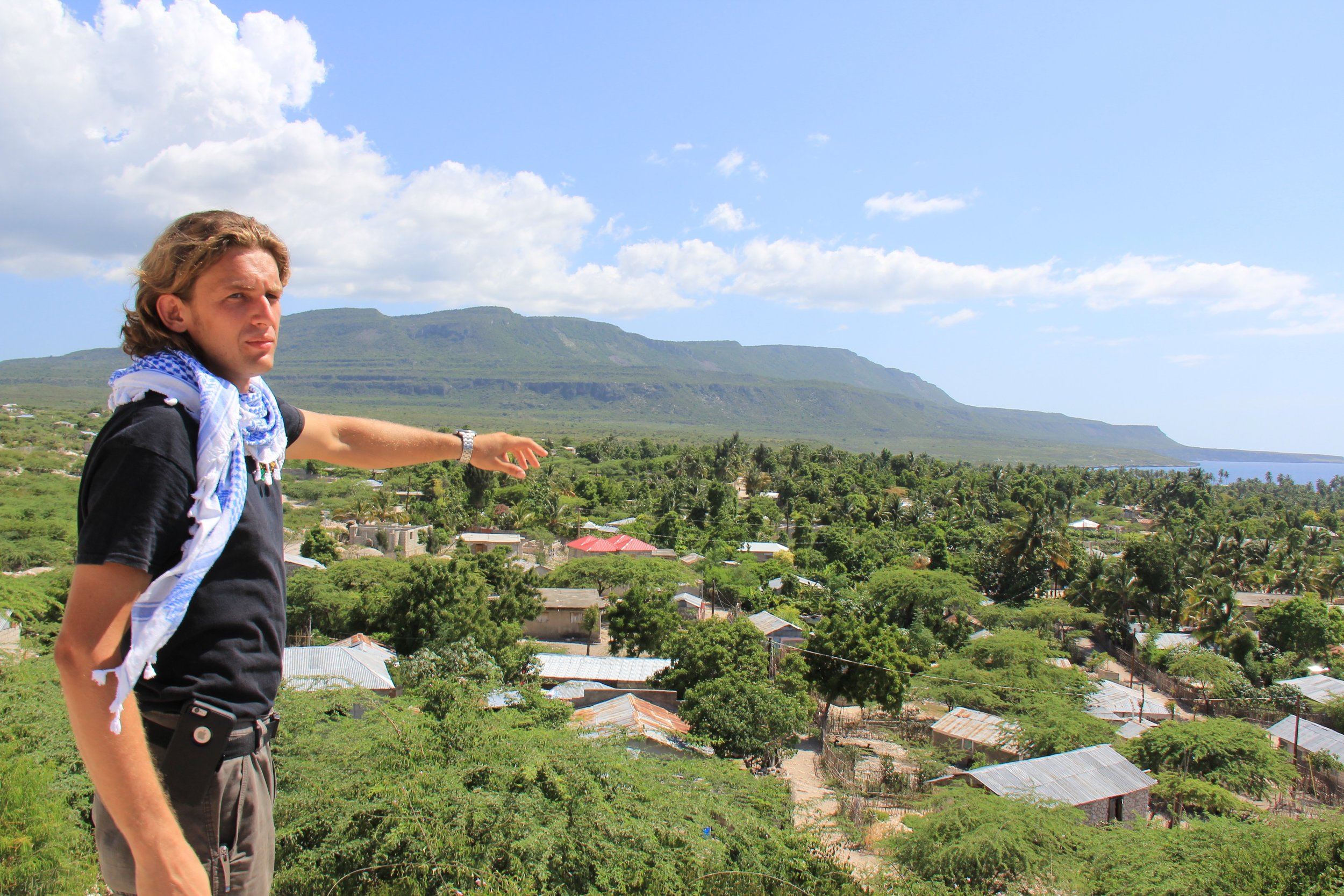 Andy Bindea looks out over the community they are electrifying in Haiti