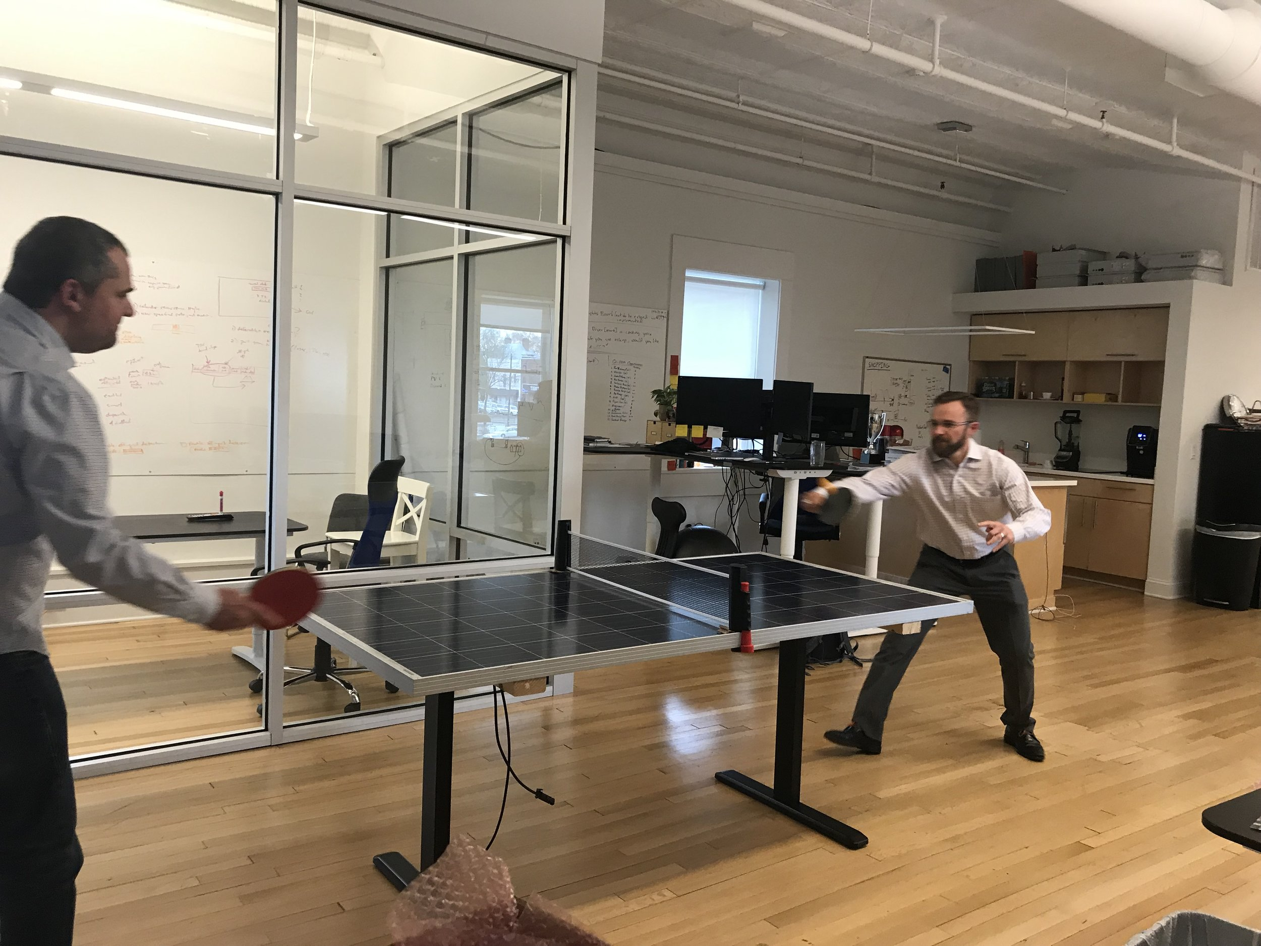 A game of SolarPong at the Lumin Office