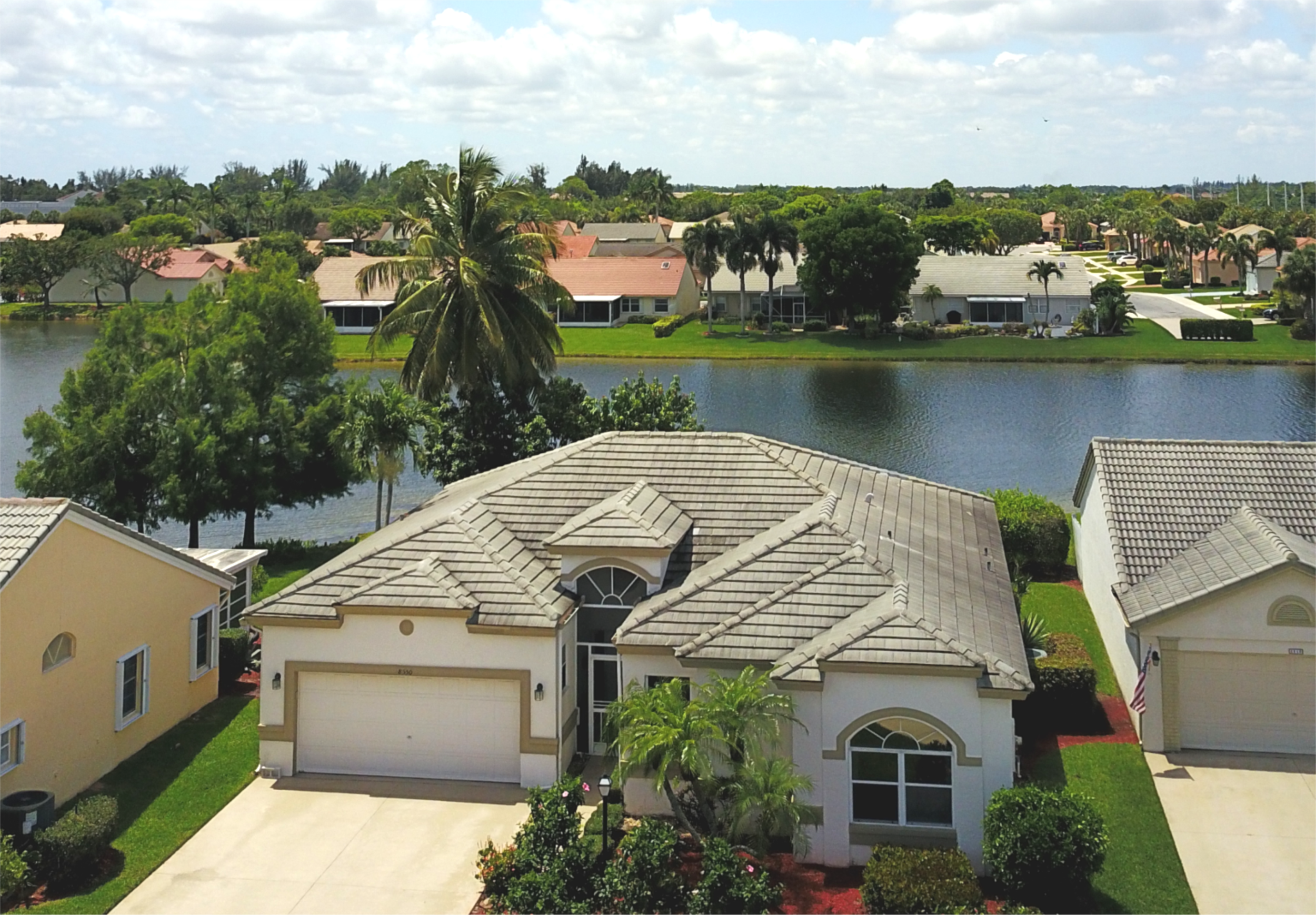 Welcome to 8550 Lake Cypress Road in West Lake Worth  Sweeping 270 degree water views in this delightful 3 BR, 2 BA CBS home. You will marvel at the tranquil, panoramic water vistas! Premium homesite in a sought-after, gated 55+ community. Spacious open floor plan ~ 1,921 sq ft under air. Ample windows illuminate the space with natural light, making the home feel extra bright & airy. Florida room with floor-to-ceiling sliders. Efficiently designed Kitchen with new SS fridge. Eat-In Breakfast Area and bay window. Large Master Suite with walk in closets. Master Bath with dual sink vanity, oversized garden tub & separate shower. Tile & laminate flooring (new) throughout. 2 car garage with extended driveway. Large open patio -- did we mention the fabulous water views? Wonderful home, outstanding community, great location.