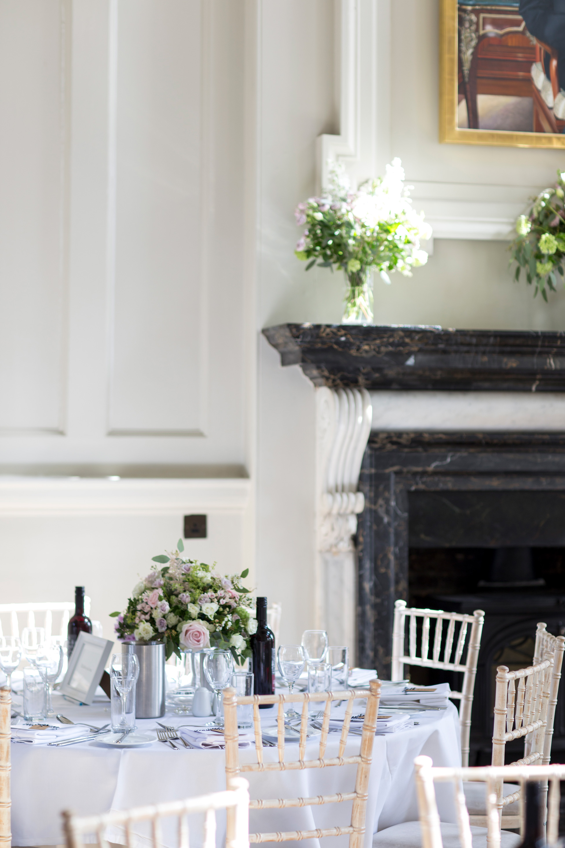 Chairs, Fireplace, Chicheley Hall, White, Green flowers, Buckinghamshire Wedding,
