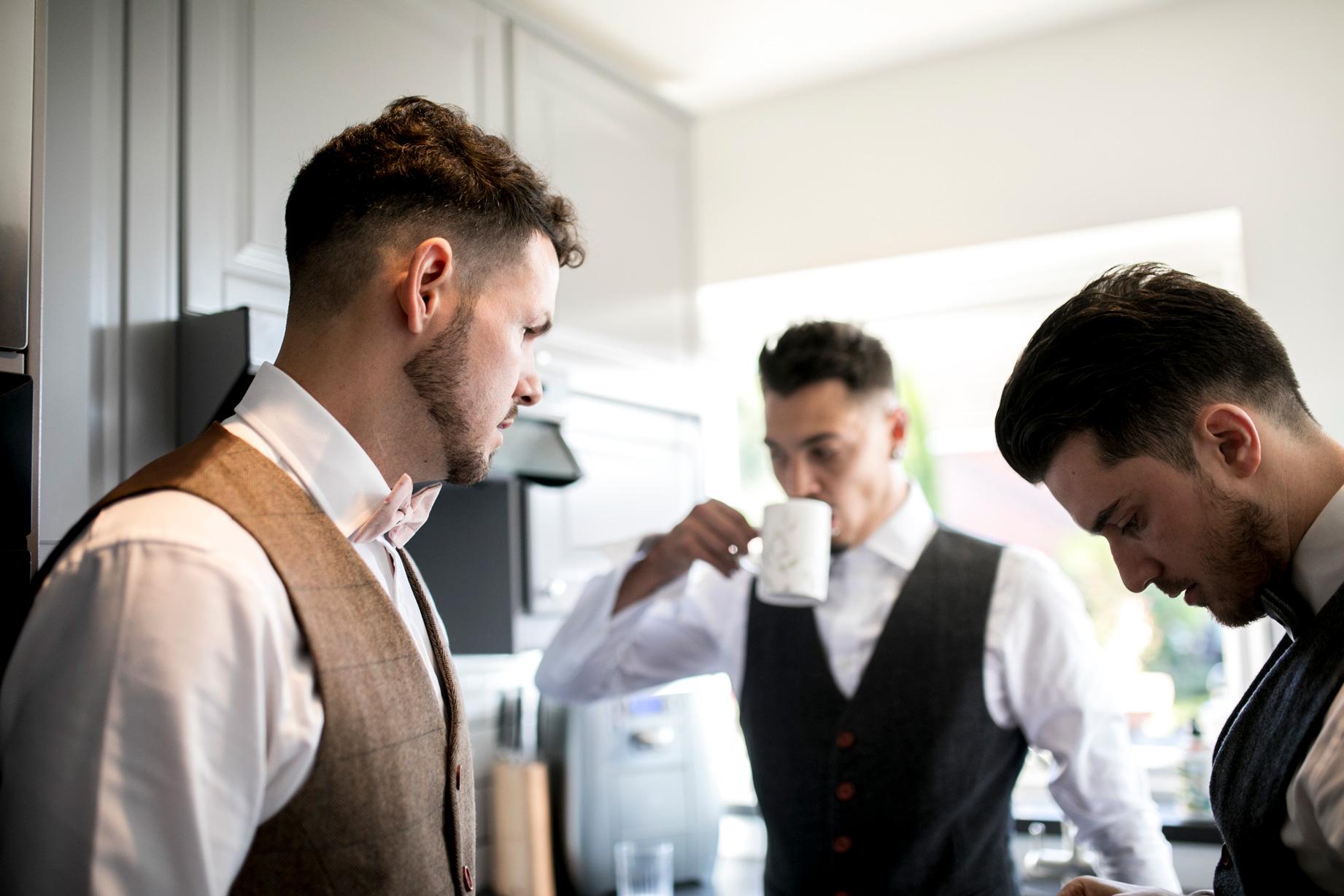grooms men in tweed having tea
