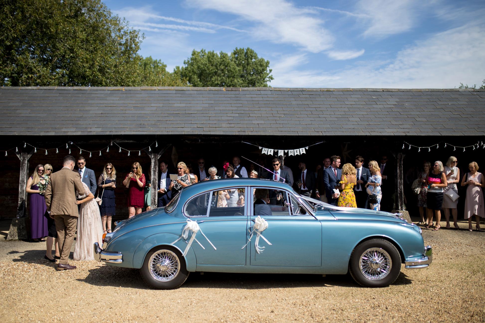 classic pale blue jaguar wedding car.jpg