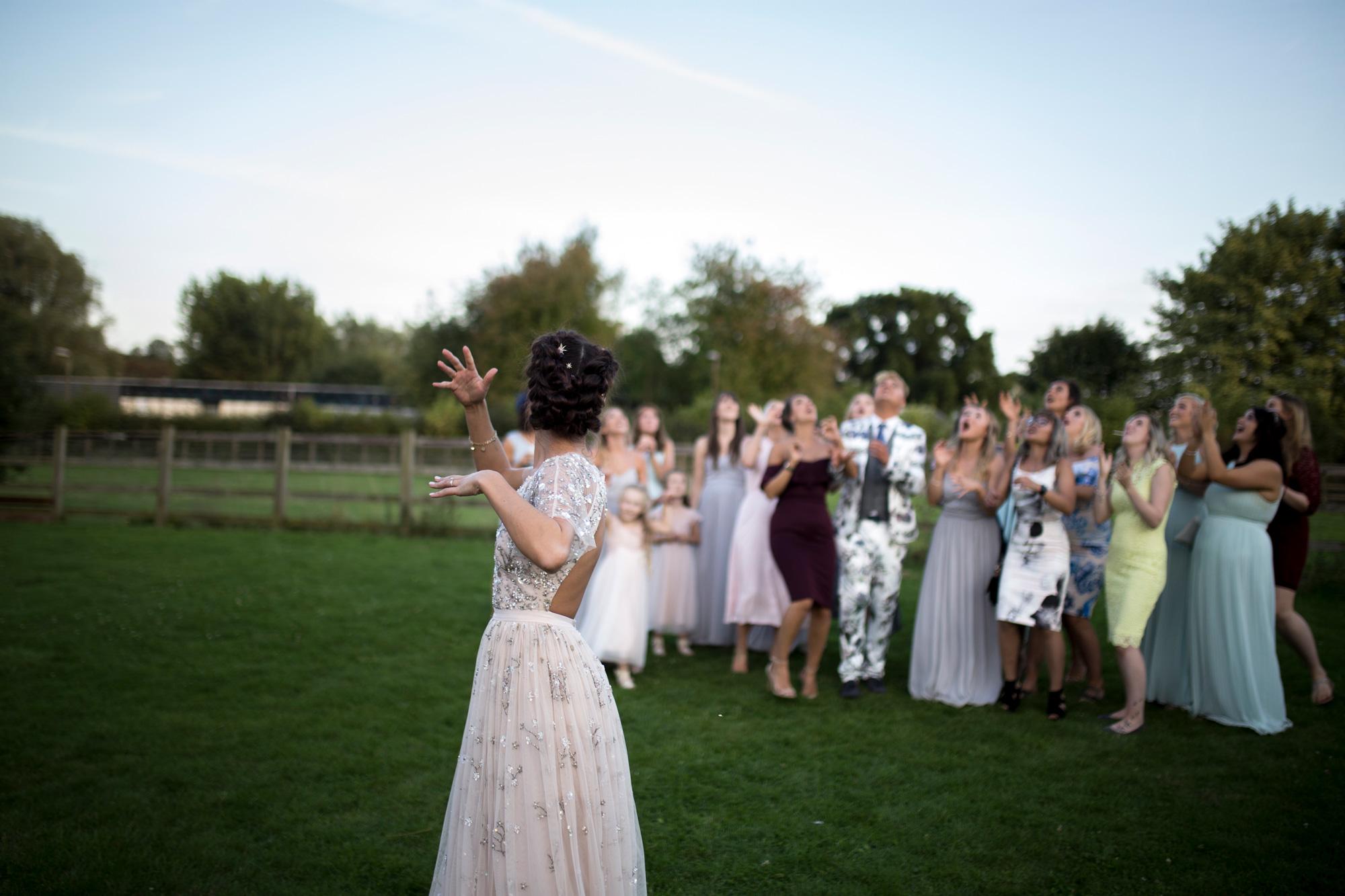 bride throwing bouquet wedding photo.jpg
