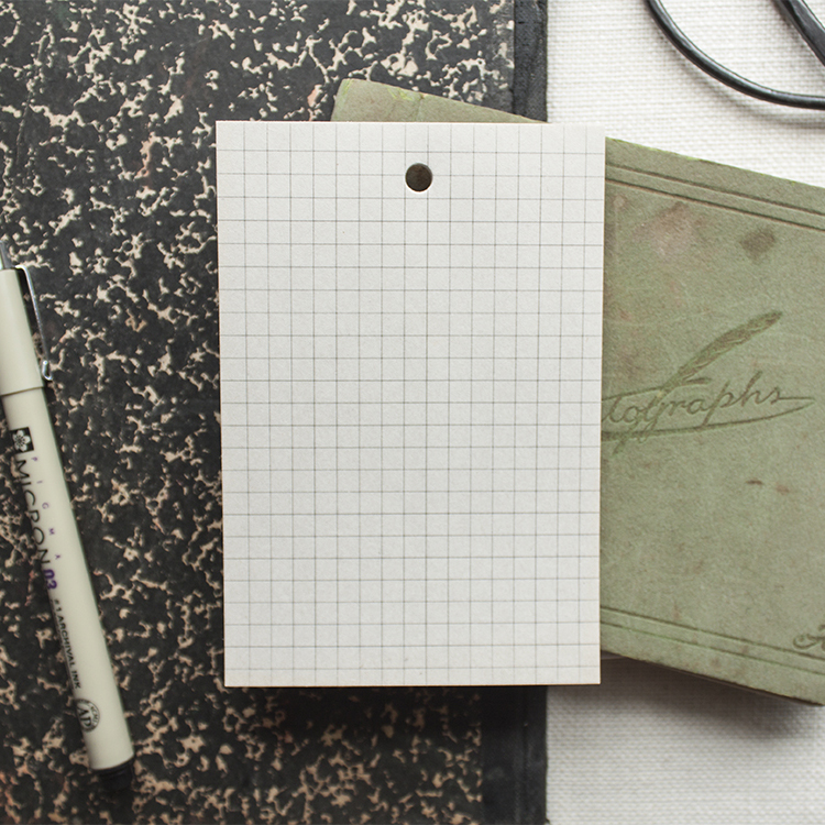 Grid Newsprint Notepad - $4.00