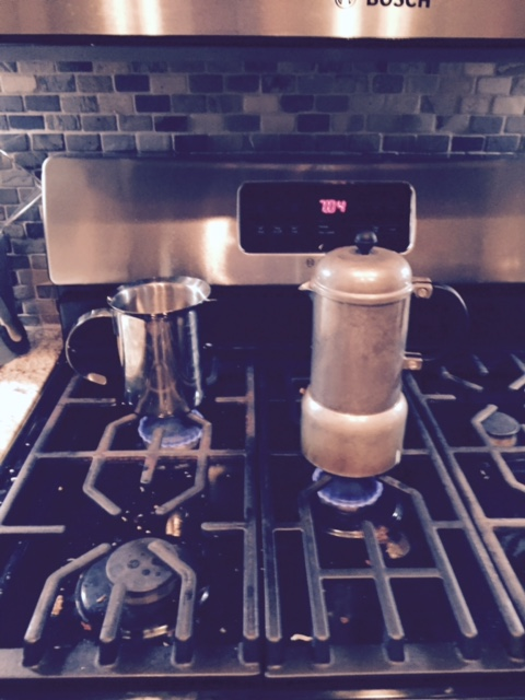 The espresso maker and frother side by side