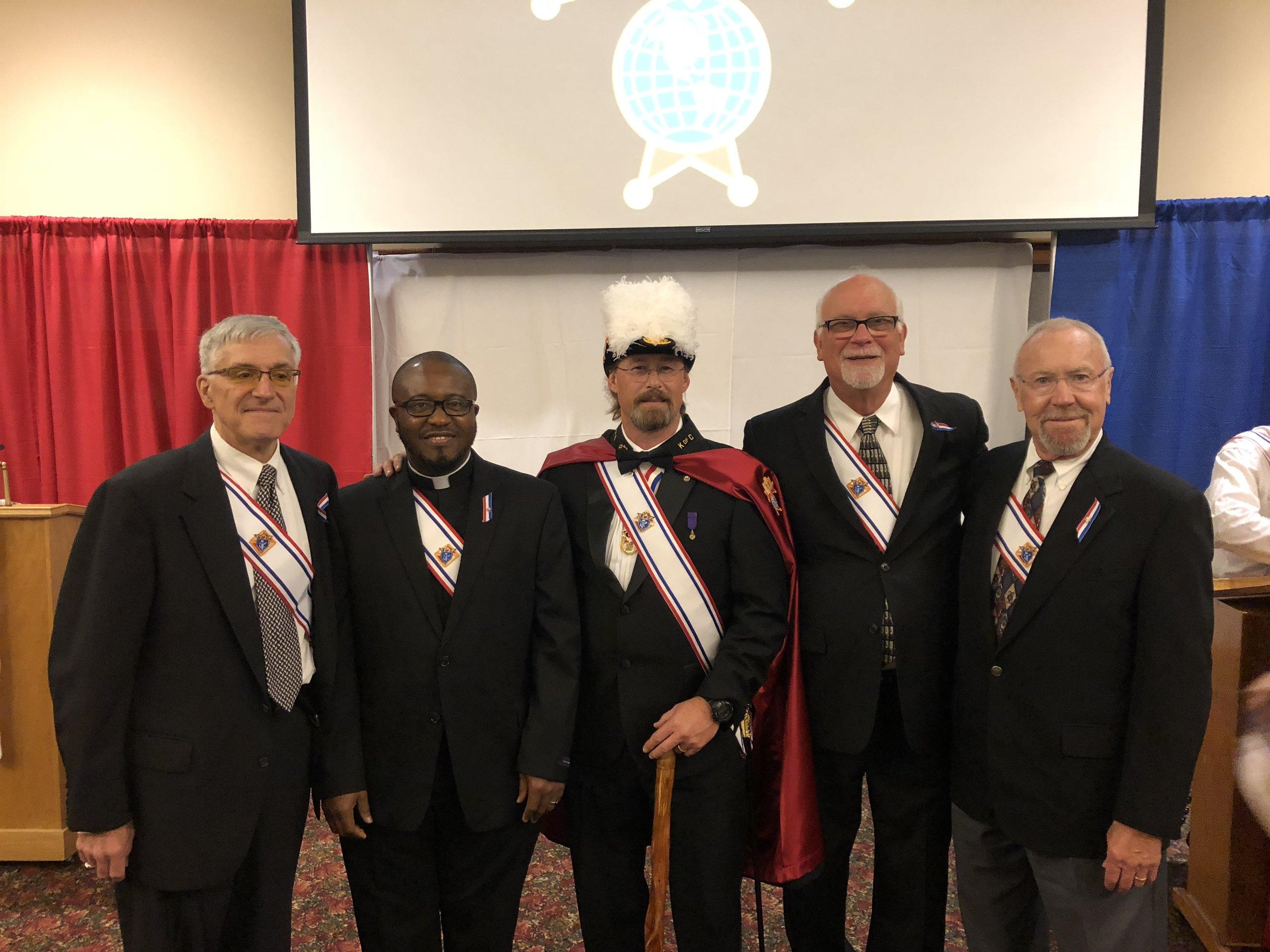 Mike Casanova, Father Bruno Nwachukwu, 4th Degree member Steven W. NaSalle, David Steehler, Bill John