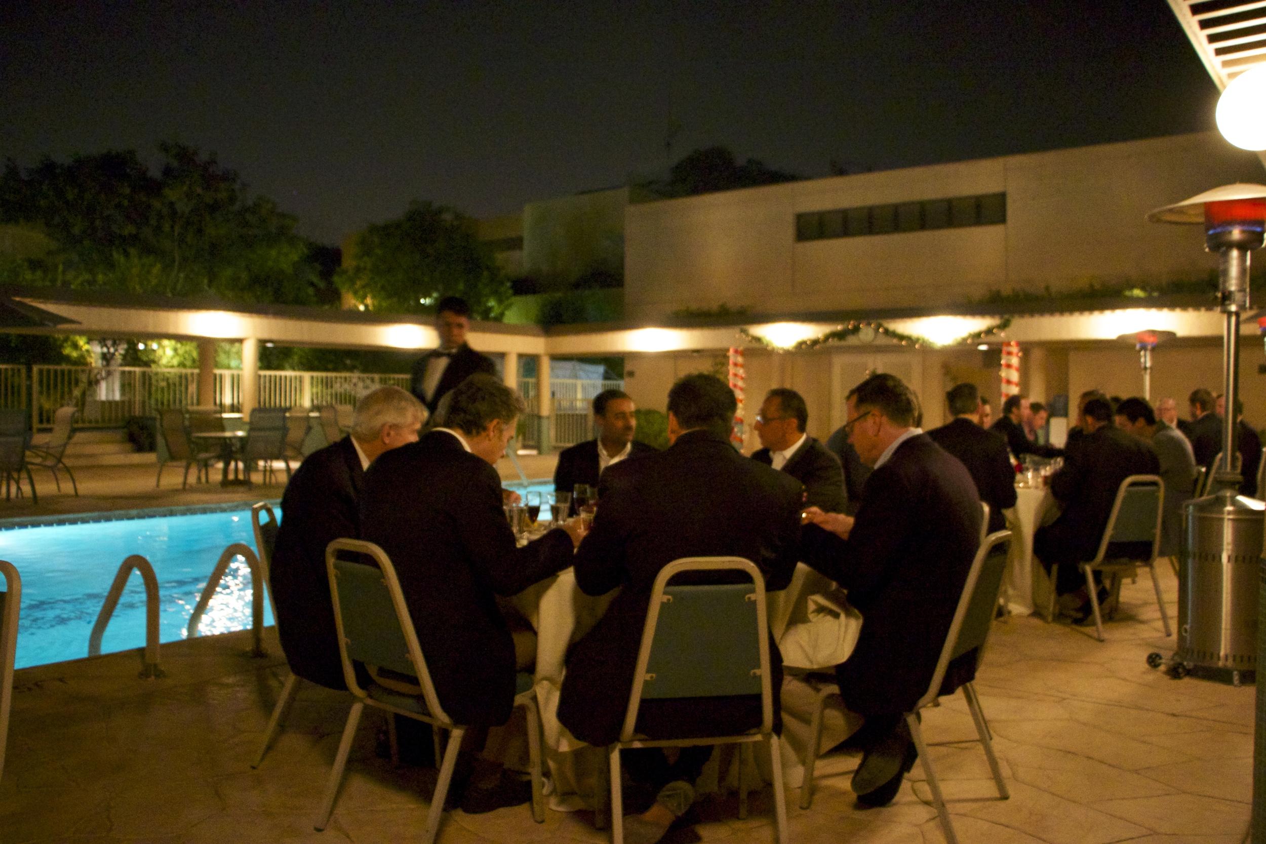 Poolside at US Ambassador's Residence;  Riyadh, Saudi Arabia. Welcome Dinner.