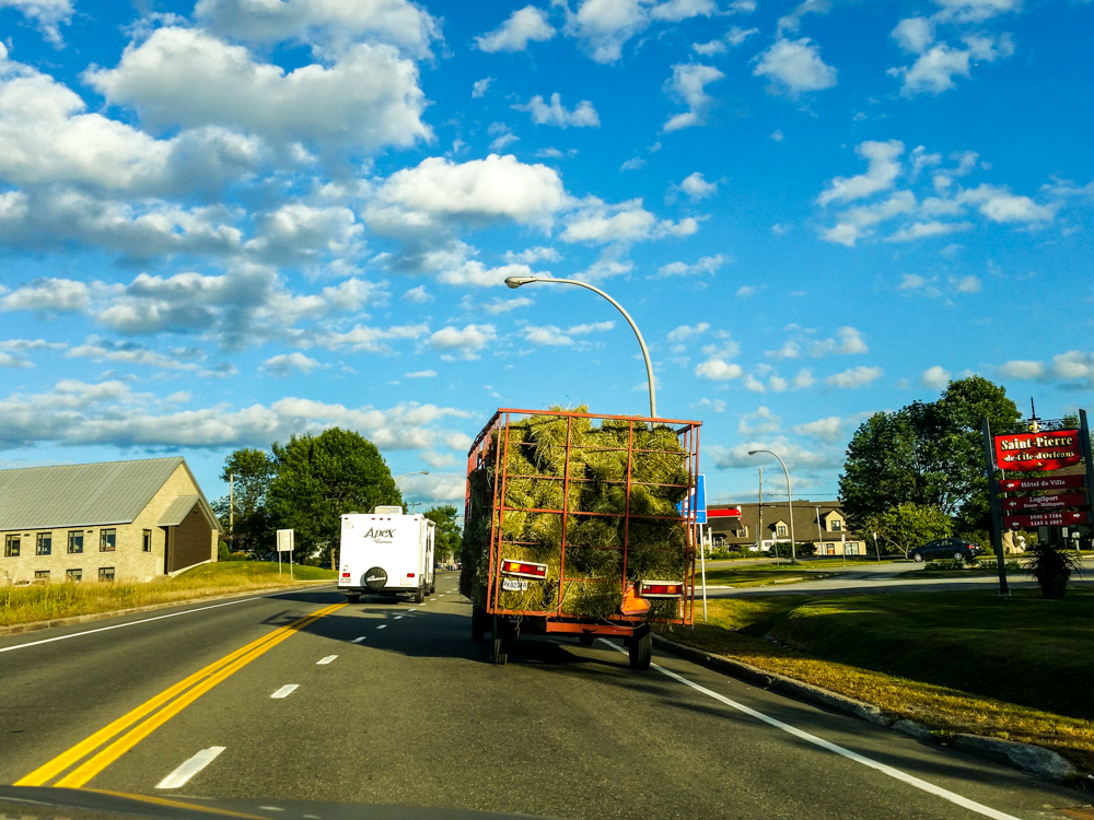 Traffic slowed up a bit entering ile de Orleans when this hay truck turned onto the road - Mobile photo (edited in Lightroom)