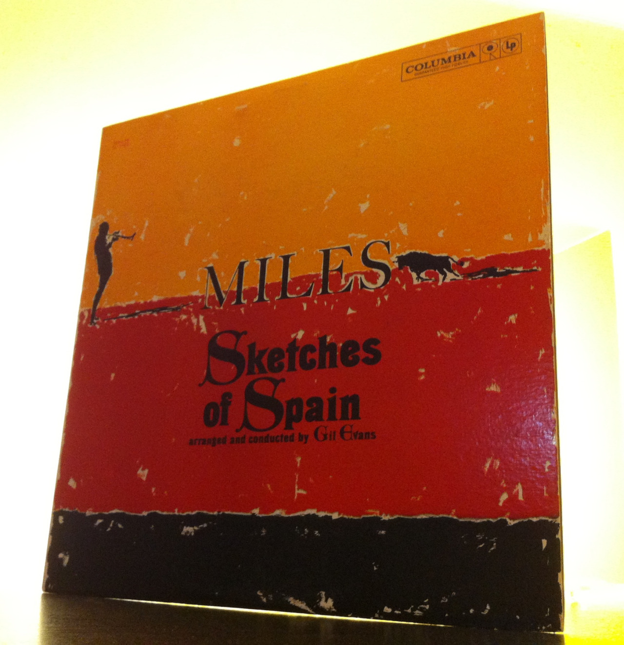 "Miles Davis And Gil Evans Create More Than Mere Sketches Of Spain.      A sketch suggests a work on its way to completion. The beginning of something with potential. The only thing preliminary about this record seems to be its length. But it's not  really  brief at 41 minutes. At least not by twelve inch record standards. The music just happens to you a bit too quickly. It leaves you wanting more. And in that way alone it seems incomplete. But satisfyingly so. Perhaps that's one of the many secrets of this record.   Recorded between Fall of 1959 and Spring of 1960, Sketches of Spain is much more than a rough draft of something more to come. It's a full, emotional portrait of a seemingly beautiful series of events we'll understand later. The orchestra and jazz group that created this masterpiece bring the compositions to life by shaping and coloring them as they play them. The album is composed of five songs magically connected to one another by Miles Davis' flugelhorn. The songs include Concierto De Aranjuez, Will O' The Wisp (from ""El Amor Brujo""), The Pan Piper, Saeta, and Solea.   As I sit here listening – first to a 1980s stereo reissue and then to an original ""six eye"" monophonic copy – I'm impressed by the picture painted by Mr. Davis and Mr. Evans. The recordings seem to be announcing something wonderfully warm but melancholy all the same. At times the record seems to be made up of a tension that builds between a tight jazz group – Miles Davis on flugelhorn, Johnny Coles on trumpet, Paul Chambers on bass, Jimmy Cobb on drums, Elvin Jones on percussion – and an open-armed orchestra that slowly surrounds them, occasionally pressuring them to deliver on their Spanish promise.   It happens to be a cool, rainy Fall day as I attempt to unravel all these Sketches of Spain and what strikes me is the incandescent swirling of amber, russet and golden hues glowing within my mind as I listen to the record over and over. The recordings themselves have warmed my heart and connected me to a time and place I've never been. And that's the rare, wonderful feeling created by Miles Davis, Sketches of Spain, arranged and conducted by Gil Evans. A jazzy, orchestral, Spanish gift to the future from so long ago.      Put on your headphones, close your eyes and float over the Iberian peninsula by clicking this very sentence.     For Weirdos Only:    As I mentioned above, I reviewed a 1980s stereo pressing and an original mono ""six-eye"" pressing. I expected huge differences between the two. The differences weren't huge. Don't get me wrong, there are differences. The mono copy has more immediacy and force. More punch. But the stereo reissue sounded good too. More enveloping. As is typical of any comparison of the same recordings pressed some thirty years apart, there's some loss of information over the years. There's just not as much music in the grooves of the reissue. So what? It's still great. Those two pressings weren't enough for me anyway. I put on a compact disc copy of Sketches of Spain from the Miles Davis/Gil Evans Complete Columbia Studio Recordings (burned from my brother's box set). While the cd sounded clear as a bell it also sounded the most different. The mixes sound different too. I bet they are. Too trebly. That said, it's not like I suddenly and shockingly thought I was listening to Jim Nabors singing the Whiffenpoof Song. It was still Miles, man. My guess? The copy to own is the original stereo six-eye Columbia pressing."