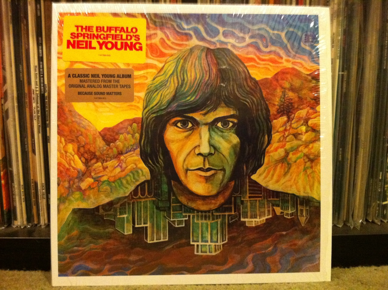 Neil Still Hates It.    Make no mistake. This record is the boiled down essence of genius. I guess I like it more than Neil Young does. But if you take Mr. Young's analysis of his own work too seriously you'd think he was a failure. This is the guy who's been working on a comprehensive box-set treatment of his entire catalog since I was in junior high school. I guess he's got an inferiority complex. That's his problem. This record is awesome.   Neil's eponymous album is nearly perfect in every way. It's the perfect transition record  between Buffalo Springfield and the Crazy Horse years (it also happens to be the only album between the two). It's heavy on careful song craft and mixing in a way that's similar to what cutting a single for Buffalo Springfield must have been like. Sure, it's overdub city. But, Neil plays all the overdubs to his advantage. Who can argue with layers and layers of Neil? Other than Neil? There's some anger and emotional purging on this record that would become more prominent on his next album with Crazy Horse (Everybody Knows This Is Nowhere). A whole lot of longing too. This guy can paint a lonely sound picture like no other.    Not too many guys are bold enough to start their solo career with an instrumental. Neil does just that with The Emperor of Wyoming. Gutsy. It sounds like it was written for a movie that plays in Neil's mind. The Loner is next. That's Neil. If I Could Have Her Tonight covers the longing angle pretty nicely as does the next cut, I've Been Waiting For You. Man, that song is so great I can listen to it over and over. The Old Laughing Lady is a tune that sounds like it should accompany a slide show about some lady you feel like you met years back. String Quartet From Whiskey Boot Hill is another instrumental and it was written by Neil's friend Jack Nitzsche. Here We Are In The Years is about a bunch of life happening all around you stuff and What Did You Do To My Life is a haunting story of a woman splitting on Neil. Sorry, man. I've Loved Her So Long has some sweetly singing female backup vocals. Insanely great.    Which brings me to this. The last cut on the album. The Last Trip To Tulsa. Fantastic. Epic. Cinematic. But what does it mean? I couldn't tell you and I've heard it a hundred and nine times. To me, it's the kind of thing I dream about when I have a fever. Maybe it's that way for Neil too. It's Neil's second installment in a series of songs which build strange image upon image throughout a long song very carefully crafted to make you feel something intense even when you can't possibly understand what's happening in it. The first Neil Young song like that? In my opinion it's Broken Arrow by Buffalo Springfield (written by Neil). Bizarre in it's vision and hideously awesome.     For weirdos only:  Take a look at the photo of the reissue LP above. It's missing Neil's name on the cover (the sticker doesn't count, Chachi). Just like the first pressing of Neil's solo debut. That album came out on Neil's birthday - November 12, 1968 - and sounded muddy enough that he quickly remixed it and re-released it early 1969 along with a new cover that proudly displays his name. The reissue I bought a couple years ago sounds awesome. You audiophile geeks probably already know how awesome it sounds. Blacker blacks. More transparency. Wider soundstage. Hahaha. And if you listen very carefully to I've Been Waiting For You, it confirms something I've long suspected. Neil needs a mint.      Listen to I've Been Waiting For You (audio only)