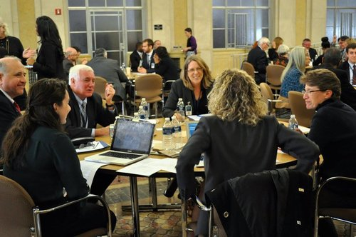 Participants talk during the breakout session; Photo Credit: American University JPO Staff