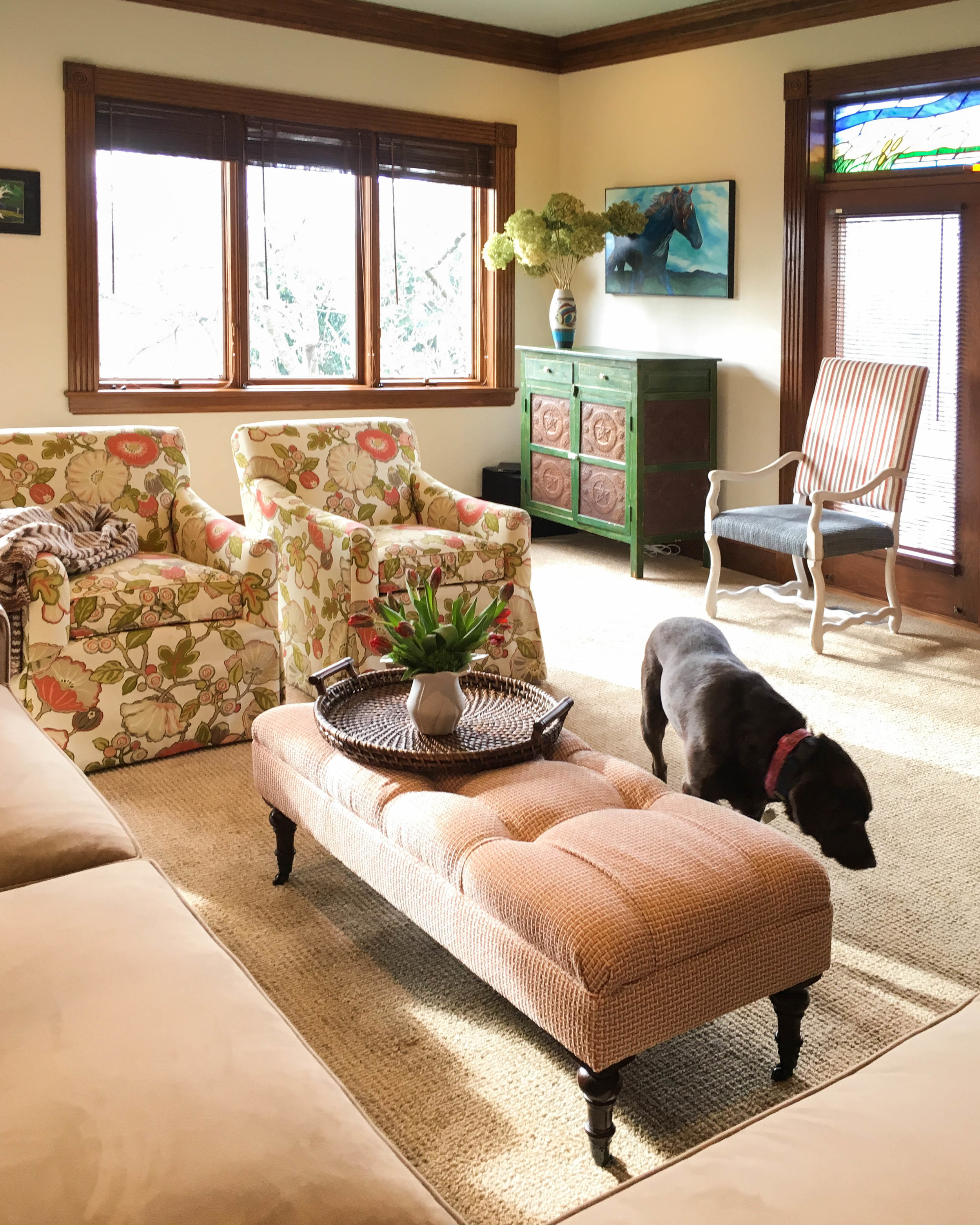 In this happy gathering room on a creek side property, one can experience the joys of each season through large wood framed windows. This served as a large part of the inspiration for this project.