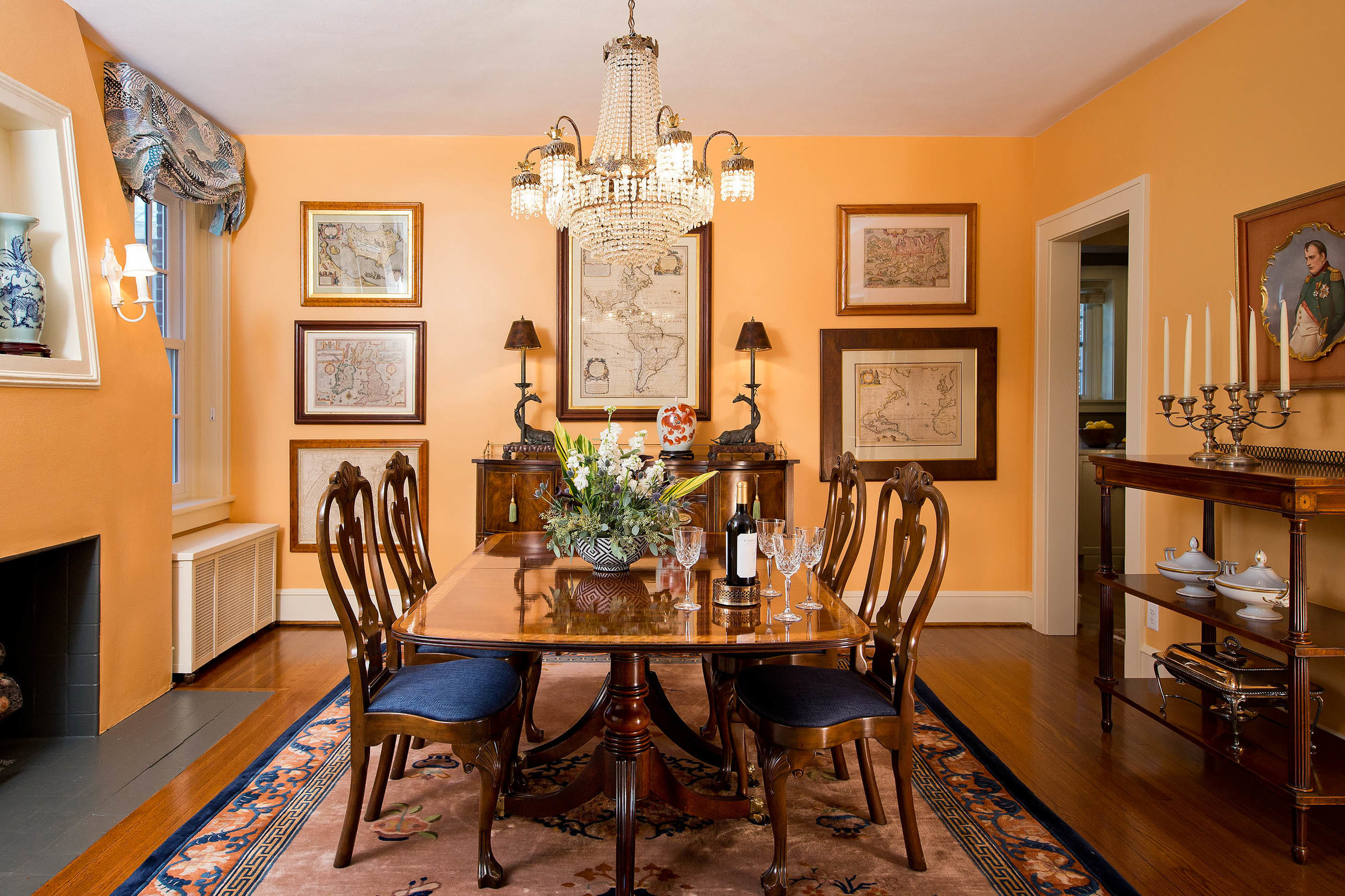 In a perfect meld of rich wood tones and playful colors and patterns, this dining room is ready for any occasion.