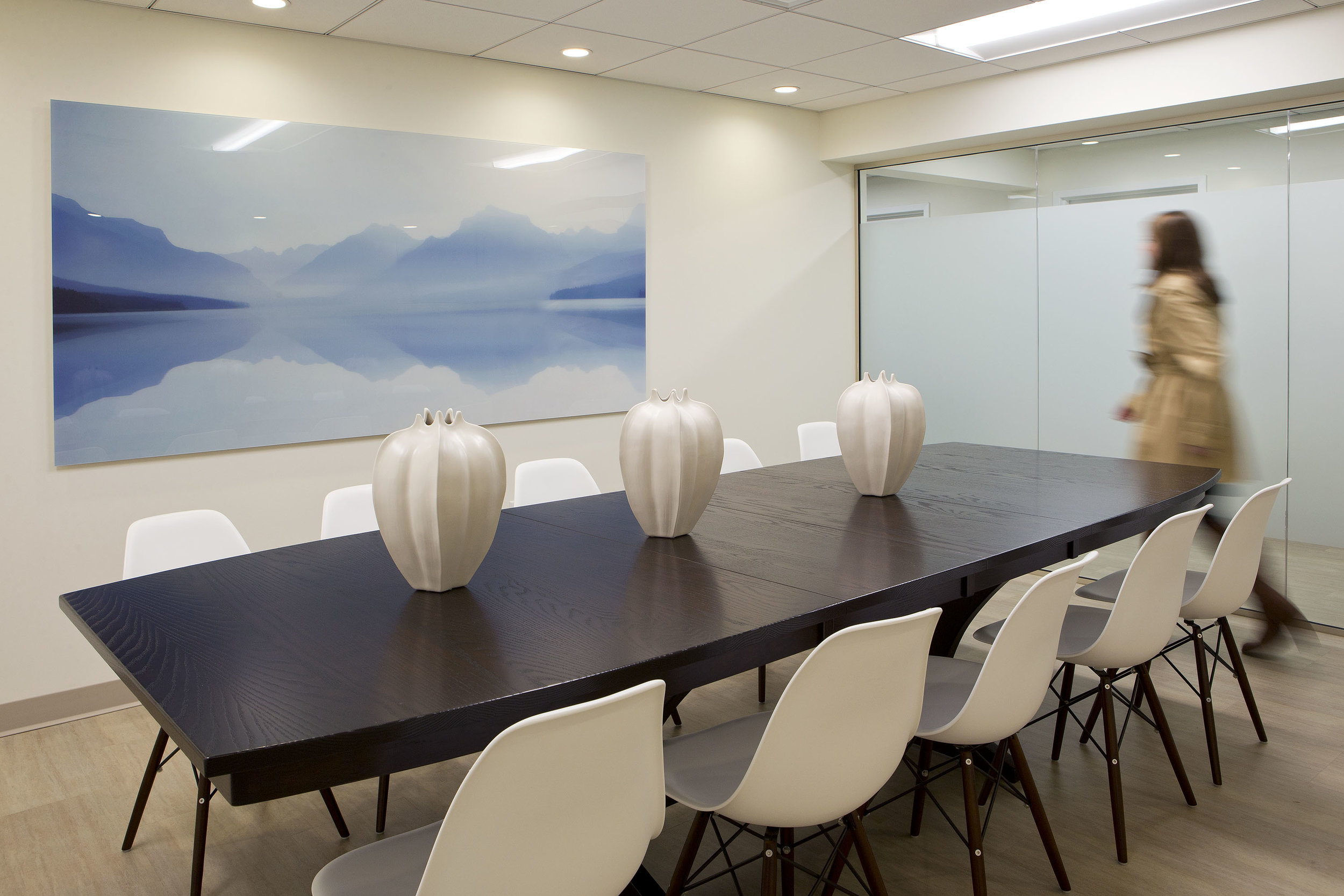 The conference room provides a serene room for meetings with the American made hardwood table comfortably seating up to ten people.