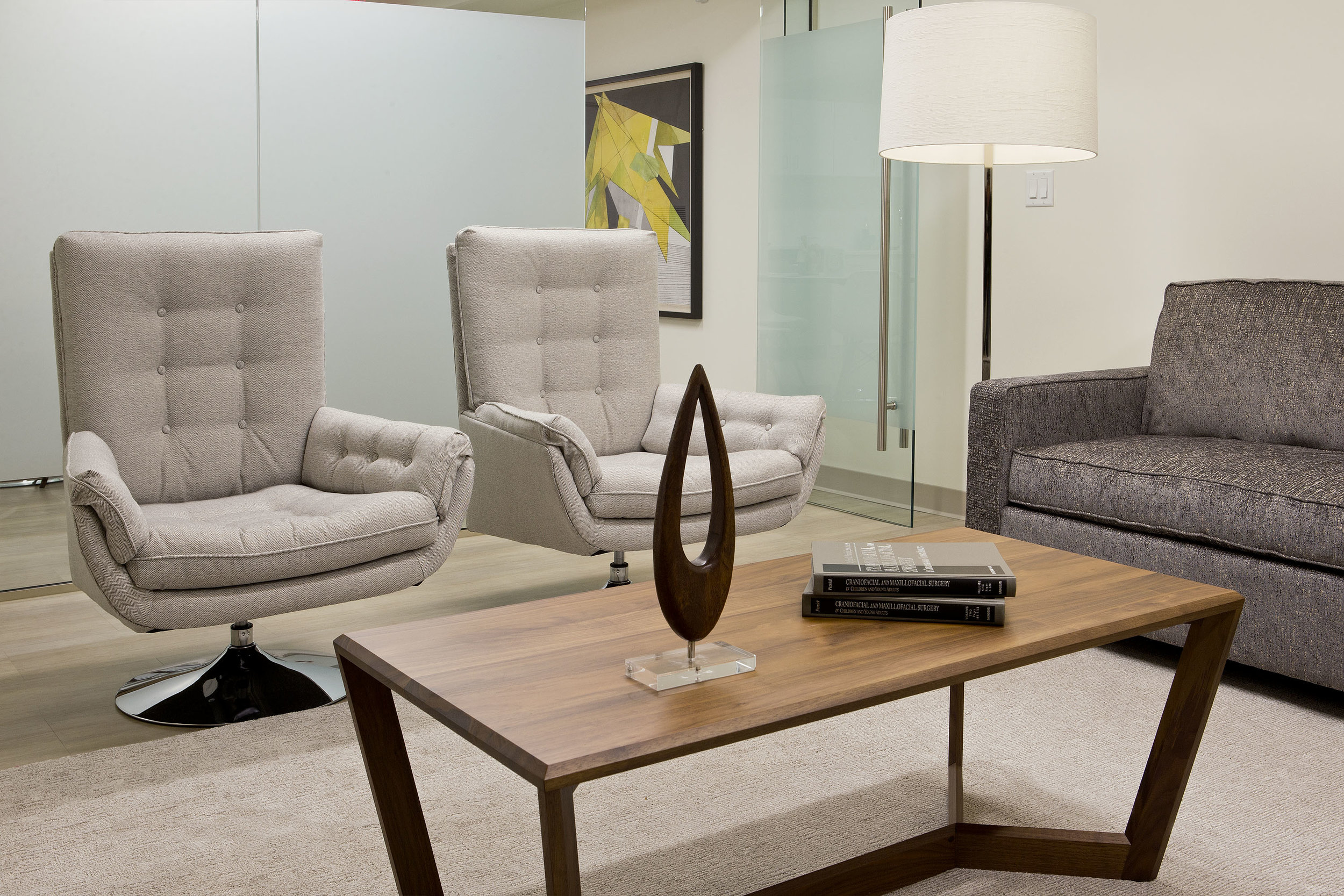 To provide the staff with a comfortable lounge area in between procedures, we grouped stylish and commercial grade seating around a walnut coffee table.