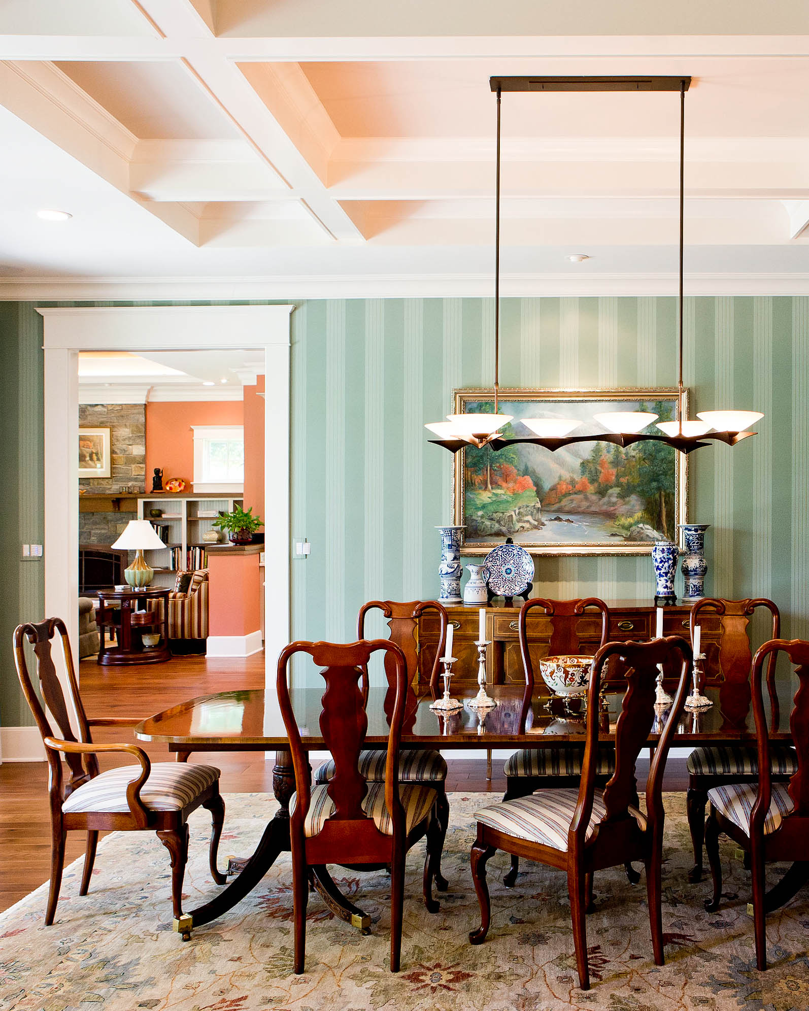 We coordinated everything in this quality design at Mason Neck, Northern Virginia. Wallpaper selection, paint color consultation, lighting design, rug selection, and custom furniture.