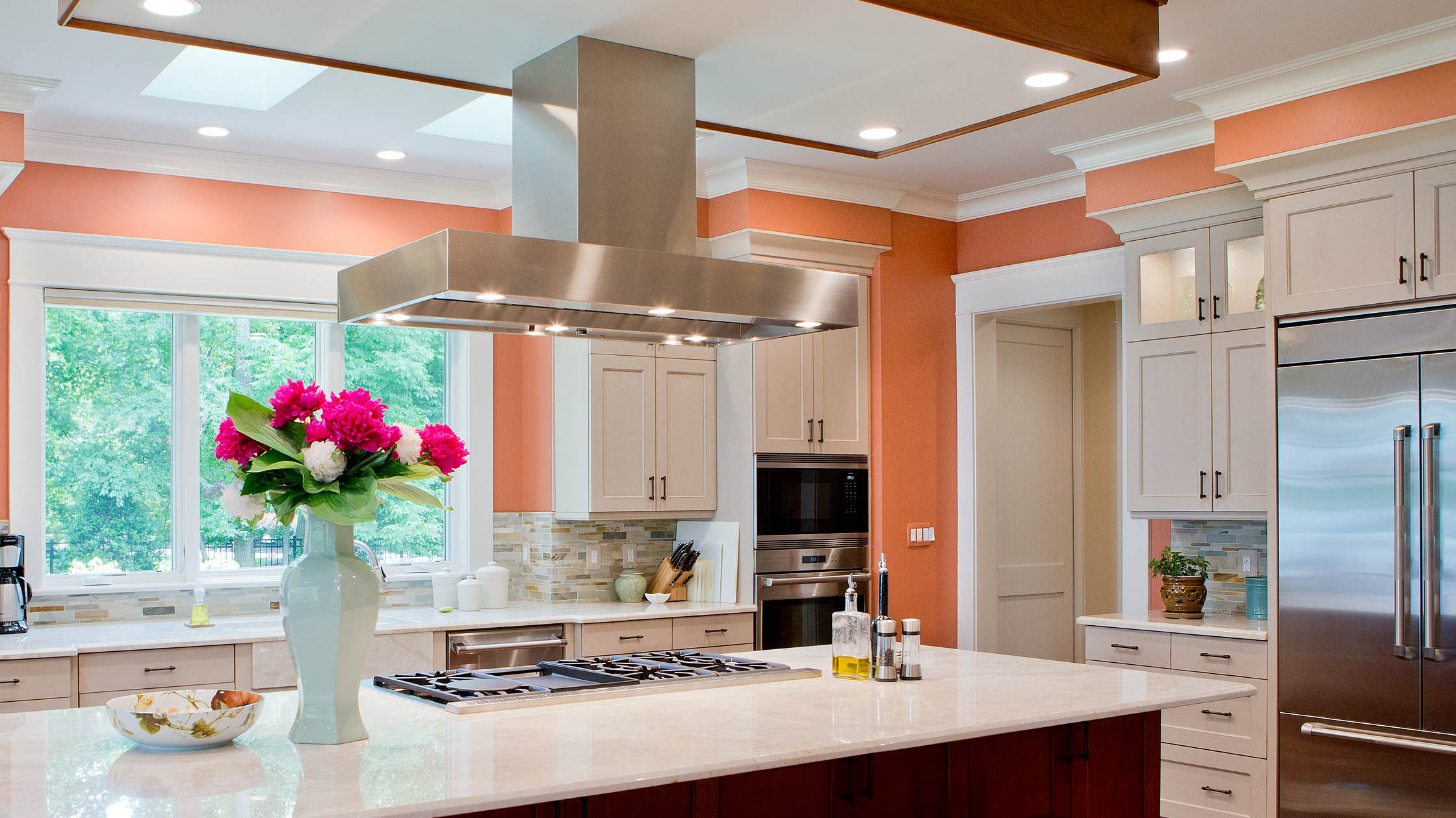 A colorful kitchen in this home outside of Alexandria, Virginia. This large Northern Virginia home has ample space to entertain guests with a large center island.