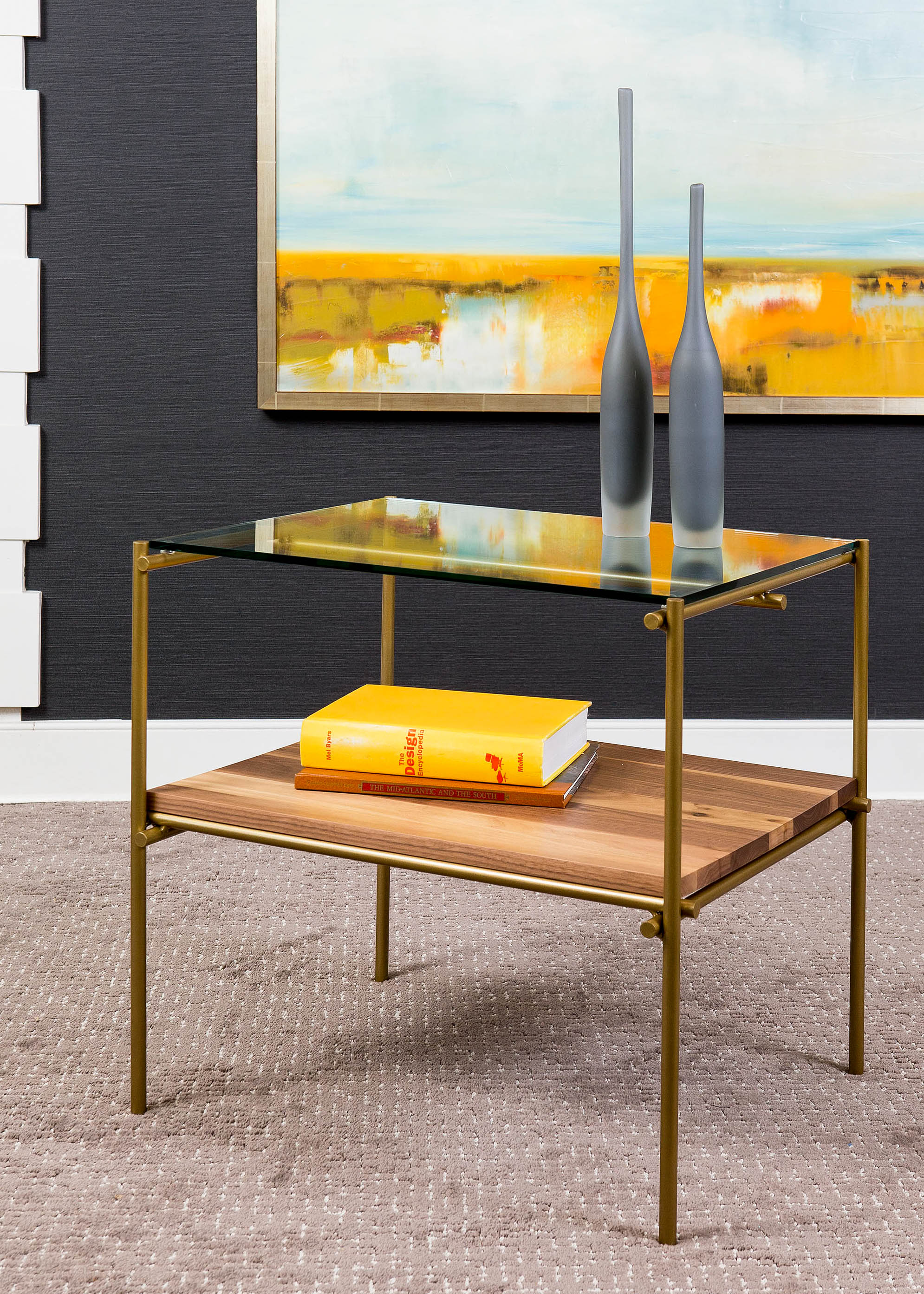 """""""It is not enough for a side table to be only functional. The silhouette and materials should add a spark of interest to your home. Our Katie table combines burnished gold, glass, and natural walnut to embody a modern, organic elegance."""" - Paul Miller, Lookbook 2019"""
