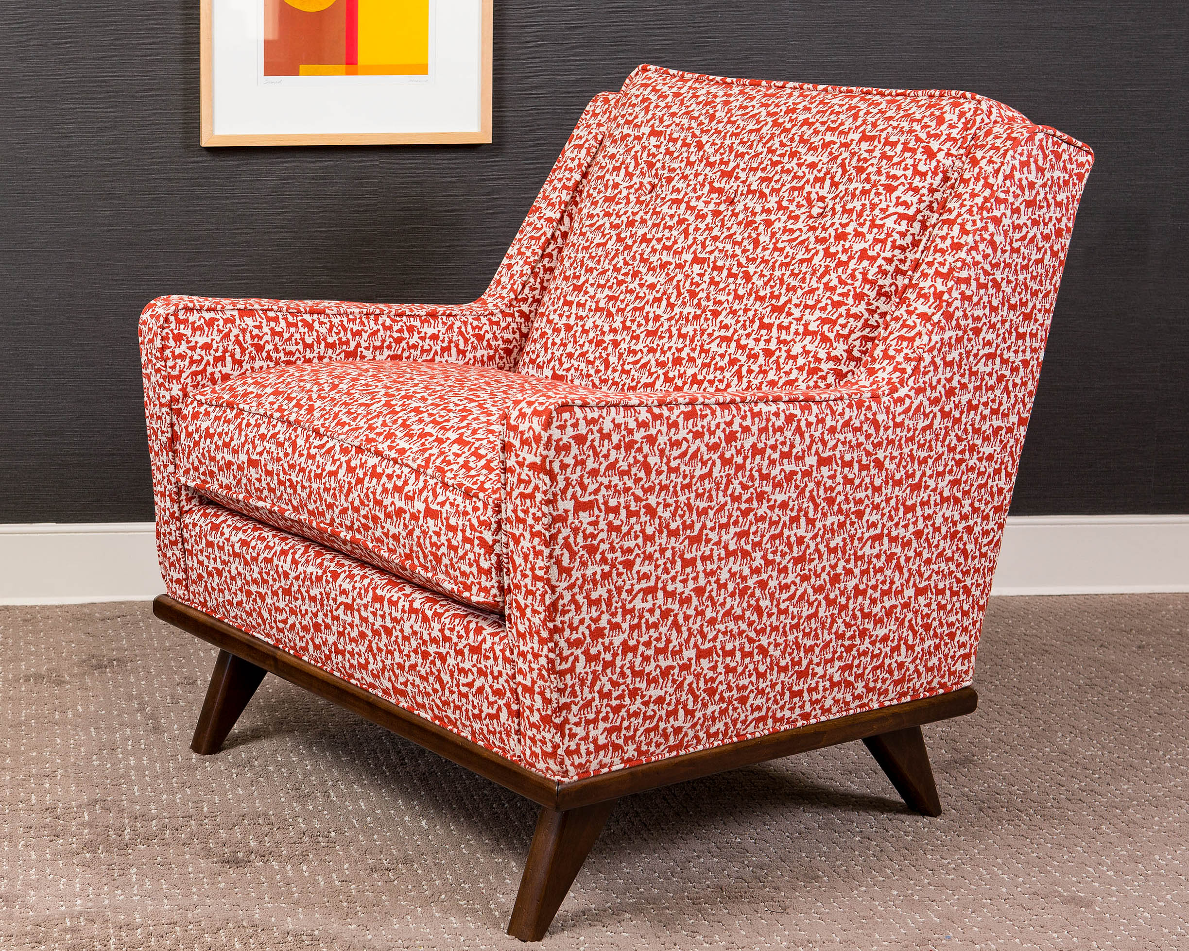 The Petrie frame comes as a chair, ottoman, or sofa. Shown here in a bold, stylish print for our Lookbook 2019.