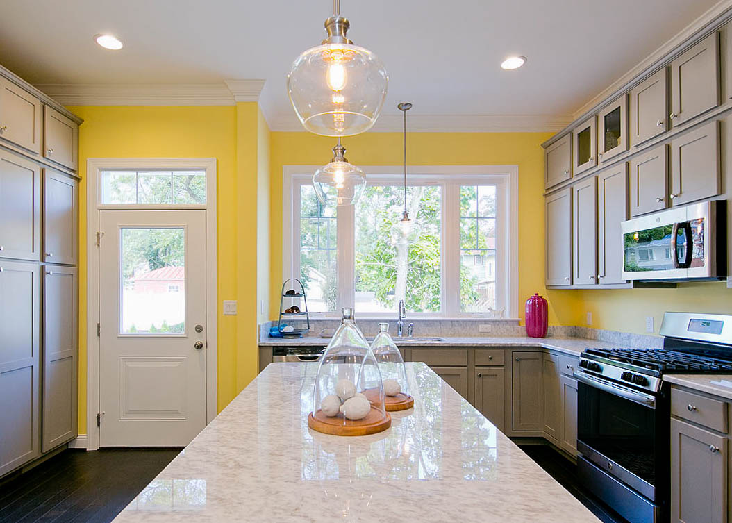 Bright painted kitchen design. Huge pantry and custom lighting. Make the biggest difference in your kitchen design with lighting and accessories. Gas stove and chrome faucet. Make your kitchen look like a model home. Beautiful countertops. Best cabinet color for kitchens. Custom kitchen design Winchester Virginia.