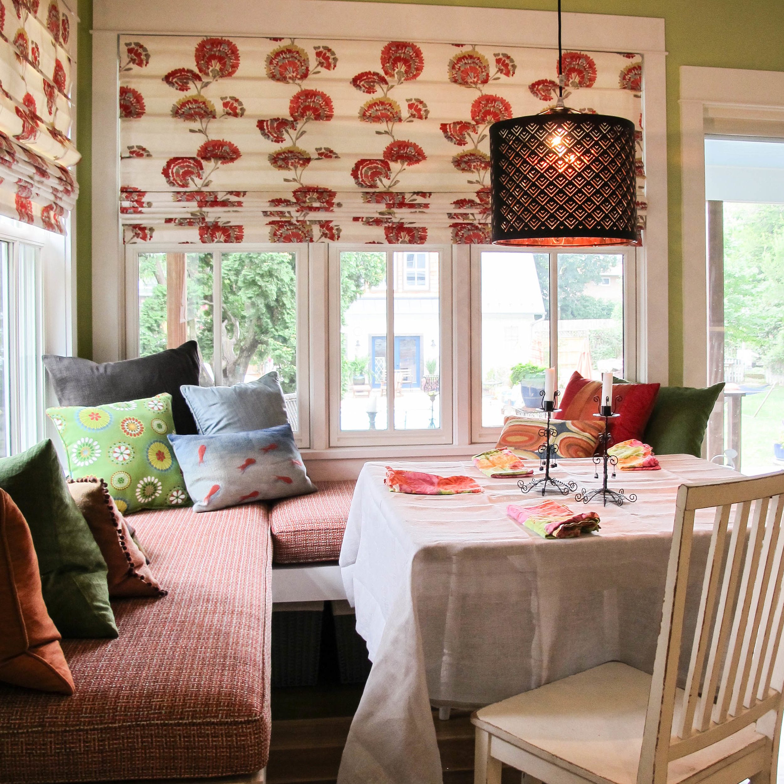 Thoughtful fabric selections and other small changes improved the overall mood in this breakfast nook.